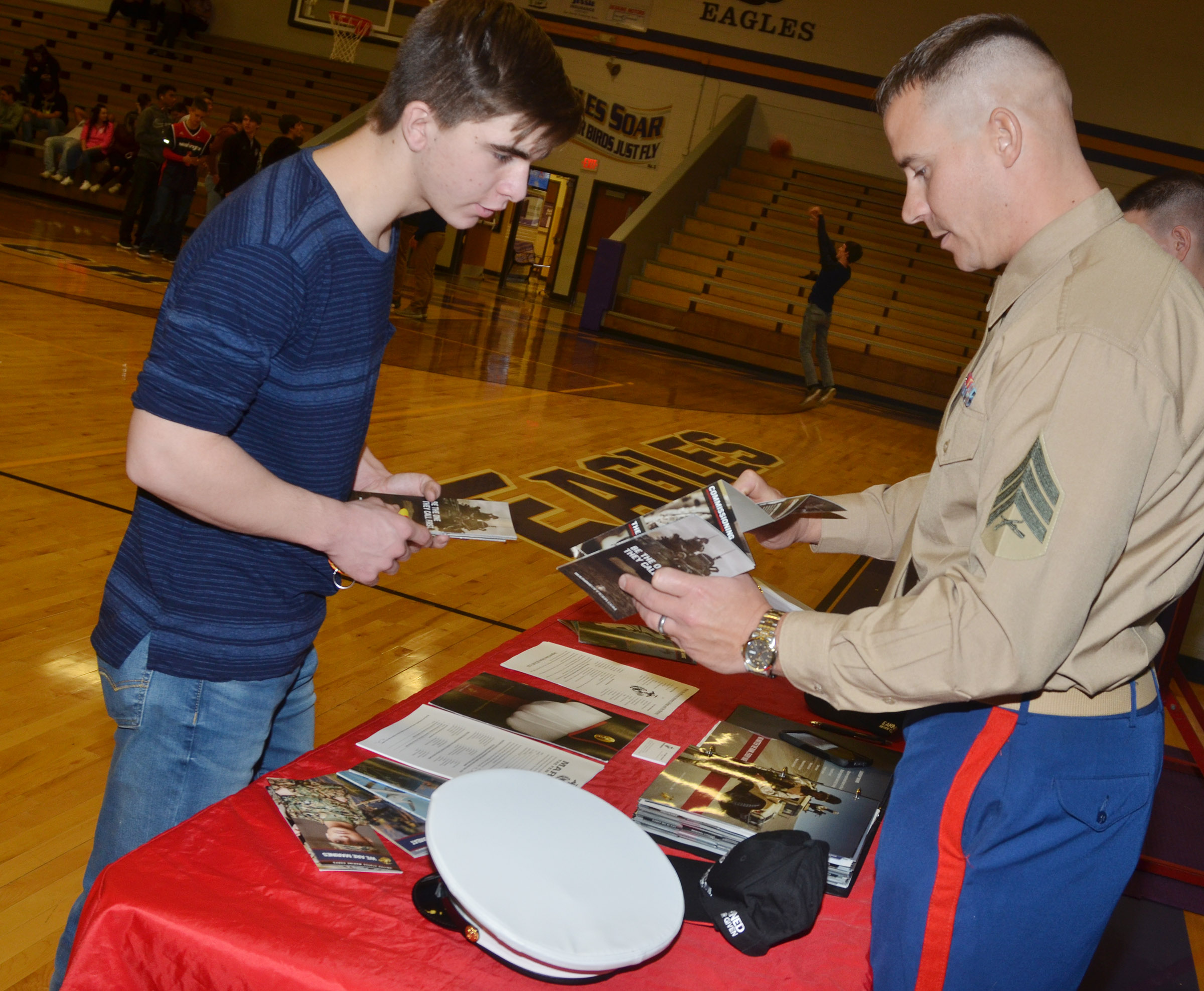 CHS junior Cass Kidwell talks with Marine recruiter Sgt. Daine Nelson.