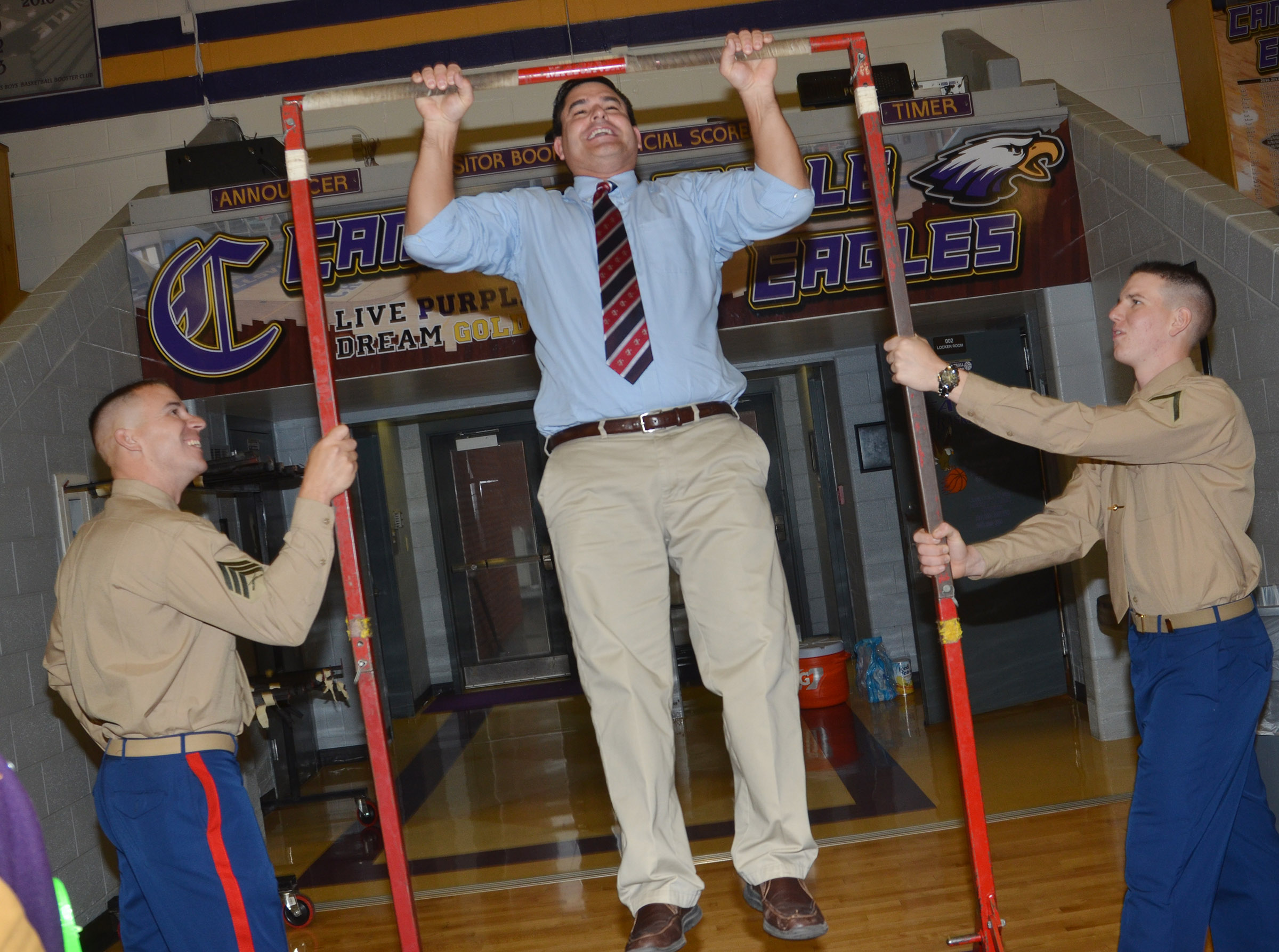 CHS Principal Kirby Smith does a pull up.