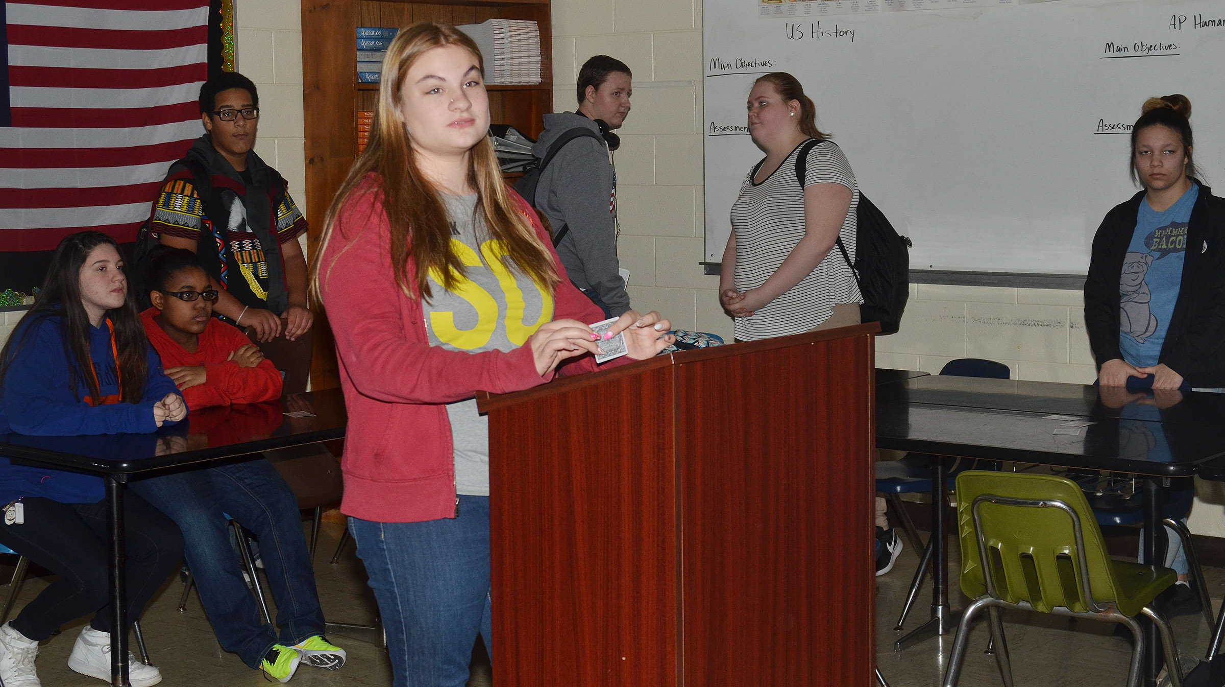 CHS freshman Samantha Underwood reads the possible answers to a question.