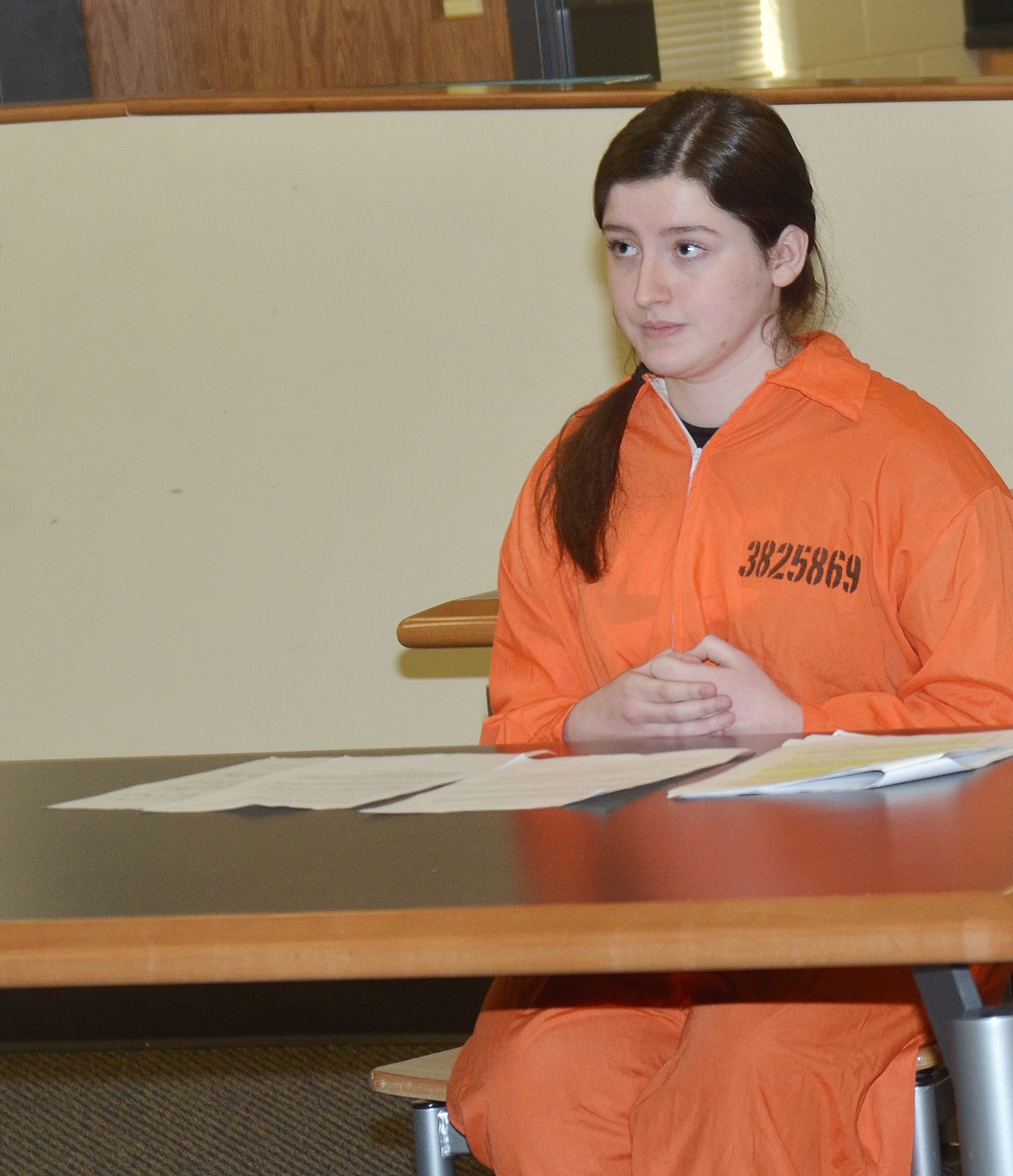 CHS sophomore Alli Wilson answers questions in her murder trial.