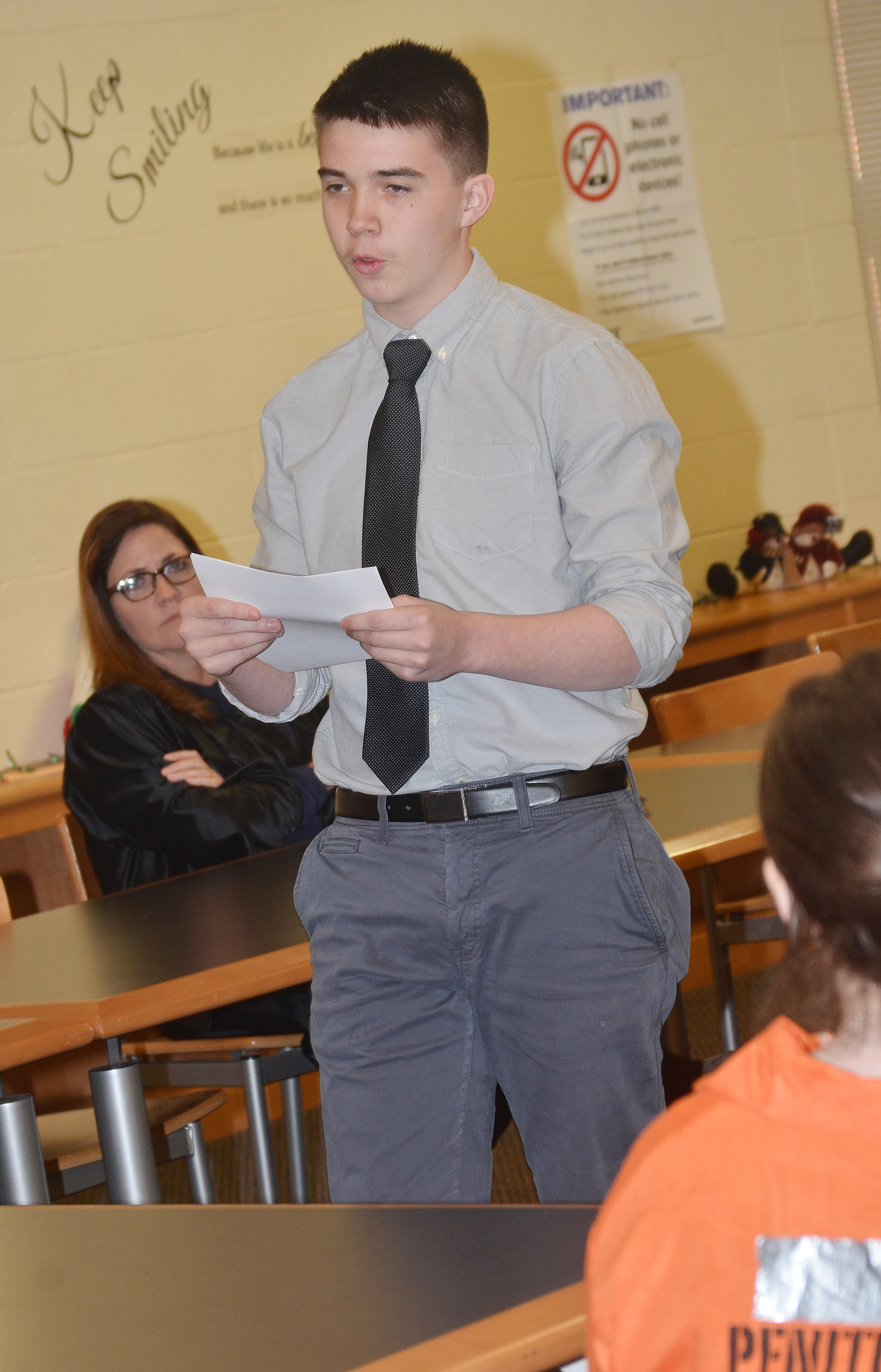 CHS sophomore Cole Kidwell, portraying a prosecutor, delivers his closing statement to the jury.