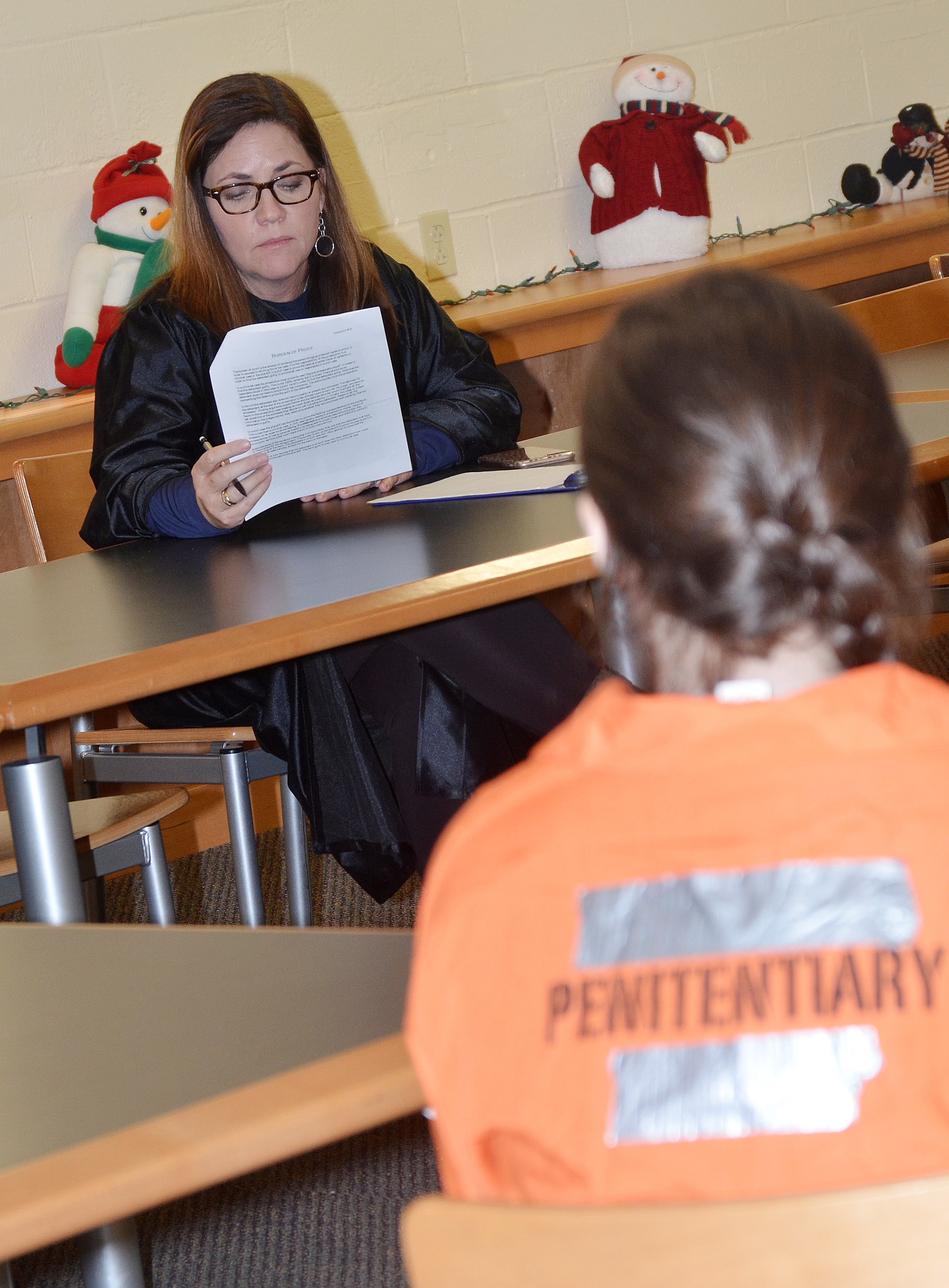 CHS teacher Susan Dabney, portraying a judge, gives instructions to the jury.