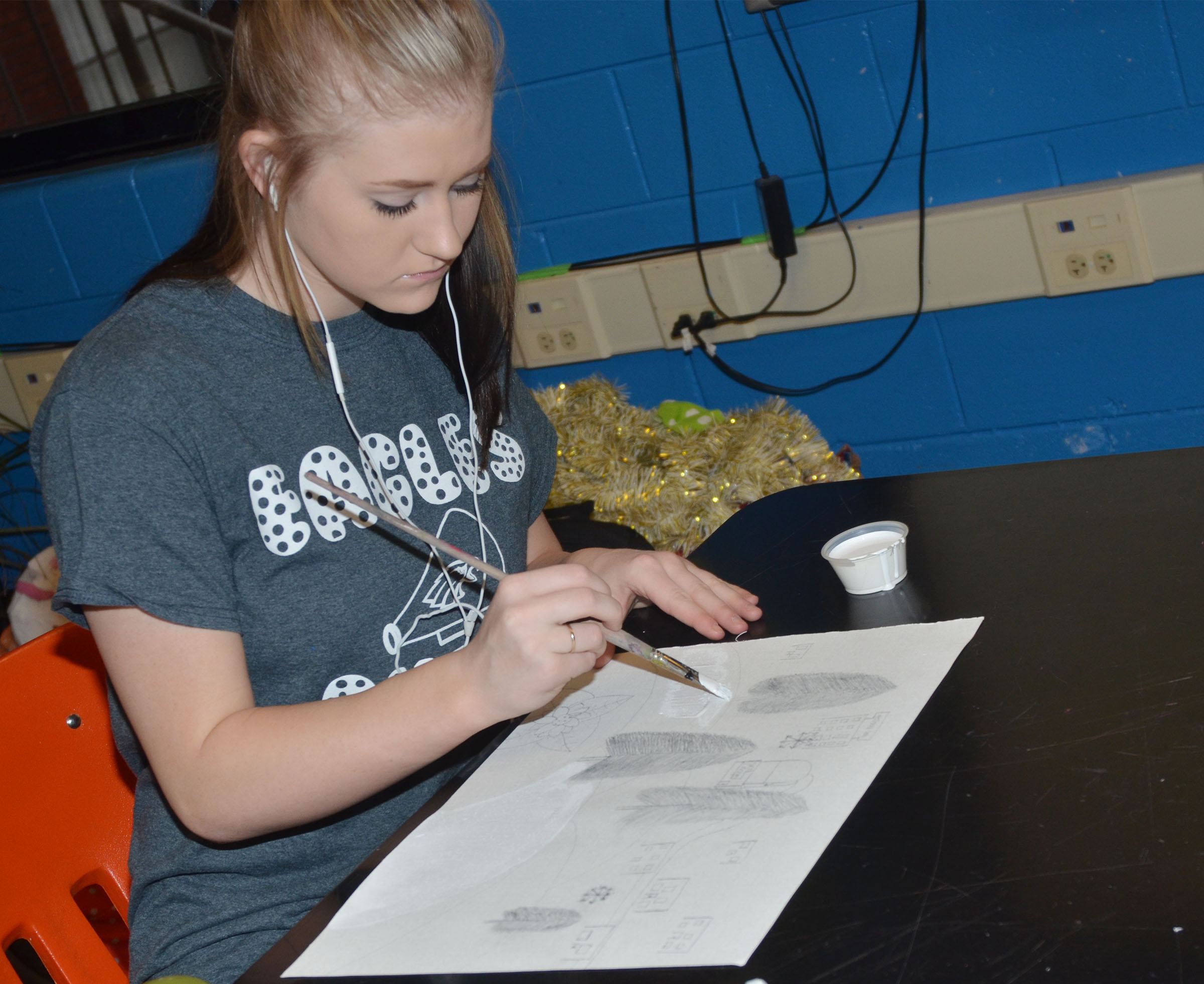 CHS freshman Isabella Osborne paints her mood painting.
