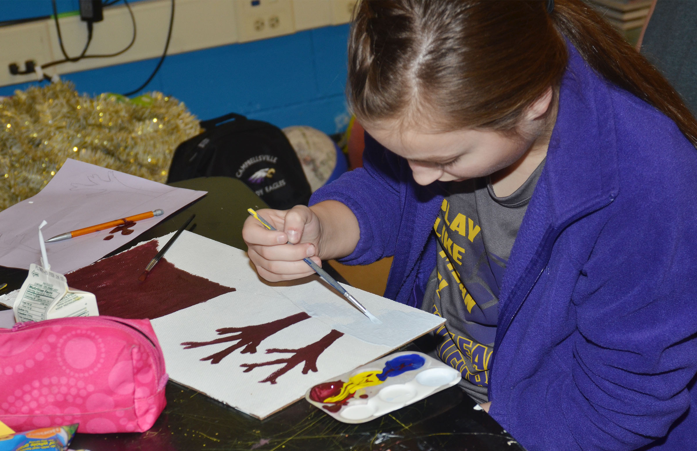 Campbellsville Middle School seventh-grader Lainey Watson paints her mood painting.