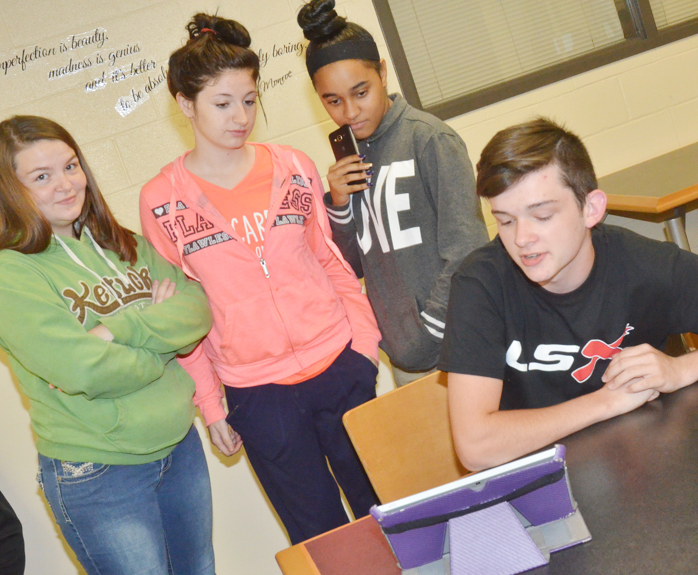 CHS junior Cameron Bohannon presents his project to, from left, Briana Brown, Savanna Bragg and Isis Coleman.
