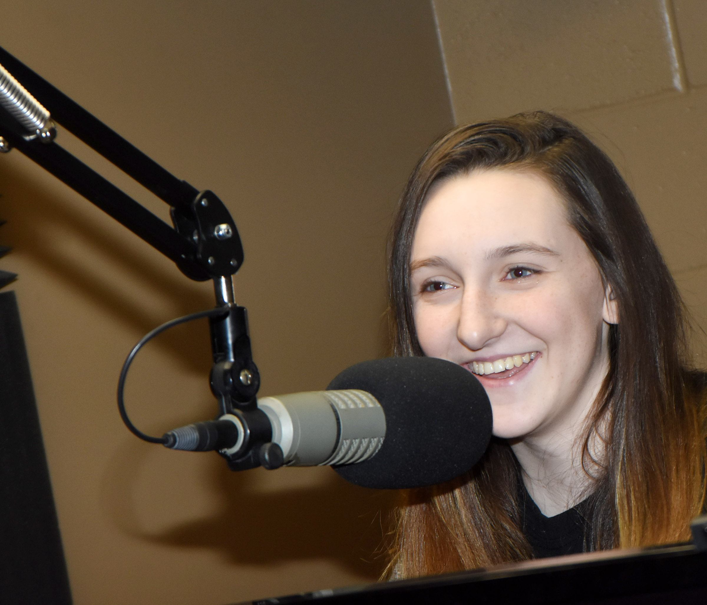 CHS junior Zoe McAninch talks on Q-104 radio station about what's happening at Campbellsville Independent Schools.