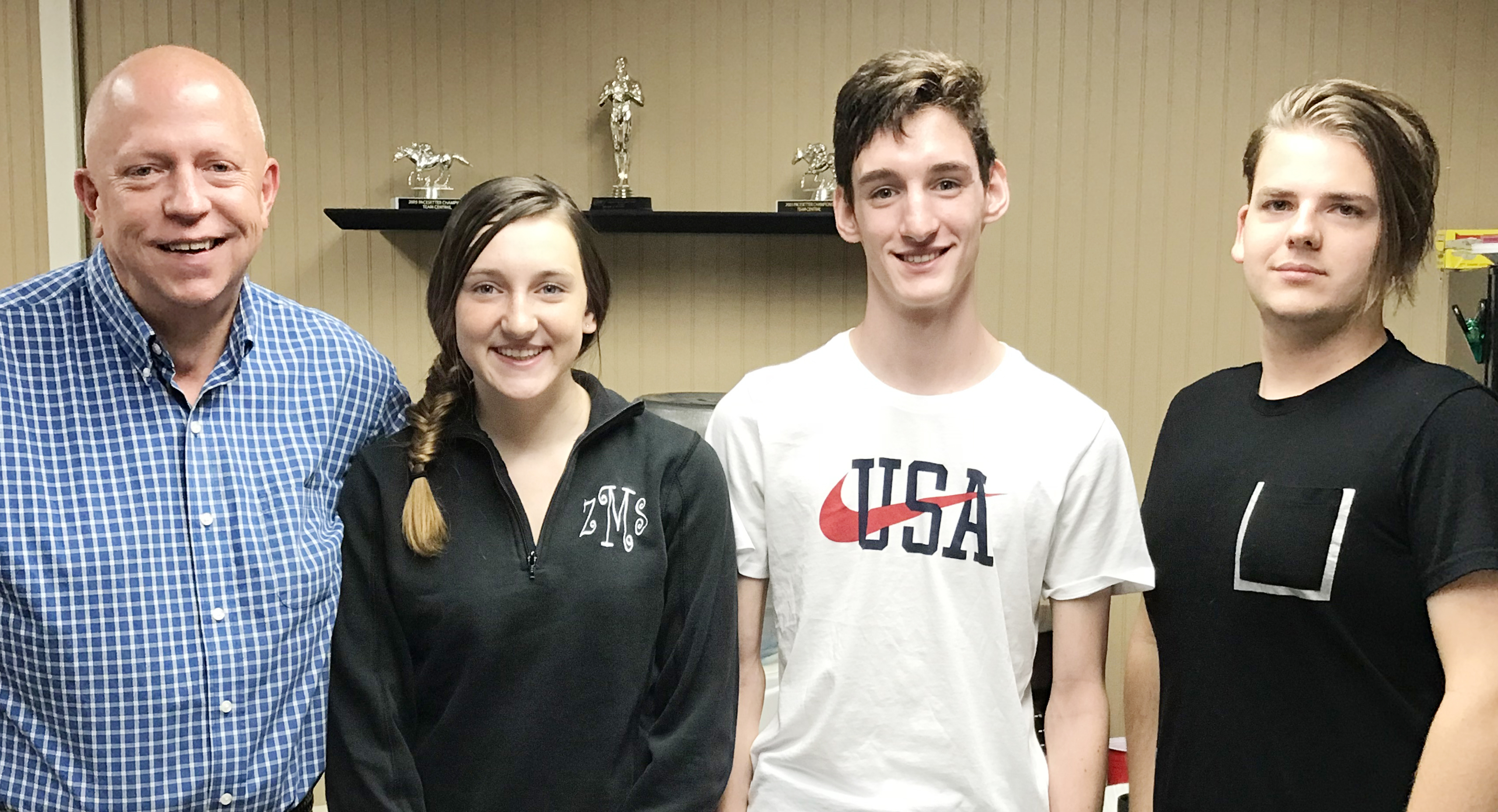 CHS junior Zoe McAninch and senior Ian McAninch are on the air each Tuesday morning at 7 a.m. with Rob Collins, at left, and Matt Rafferty on Q-104.
