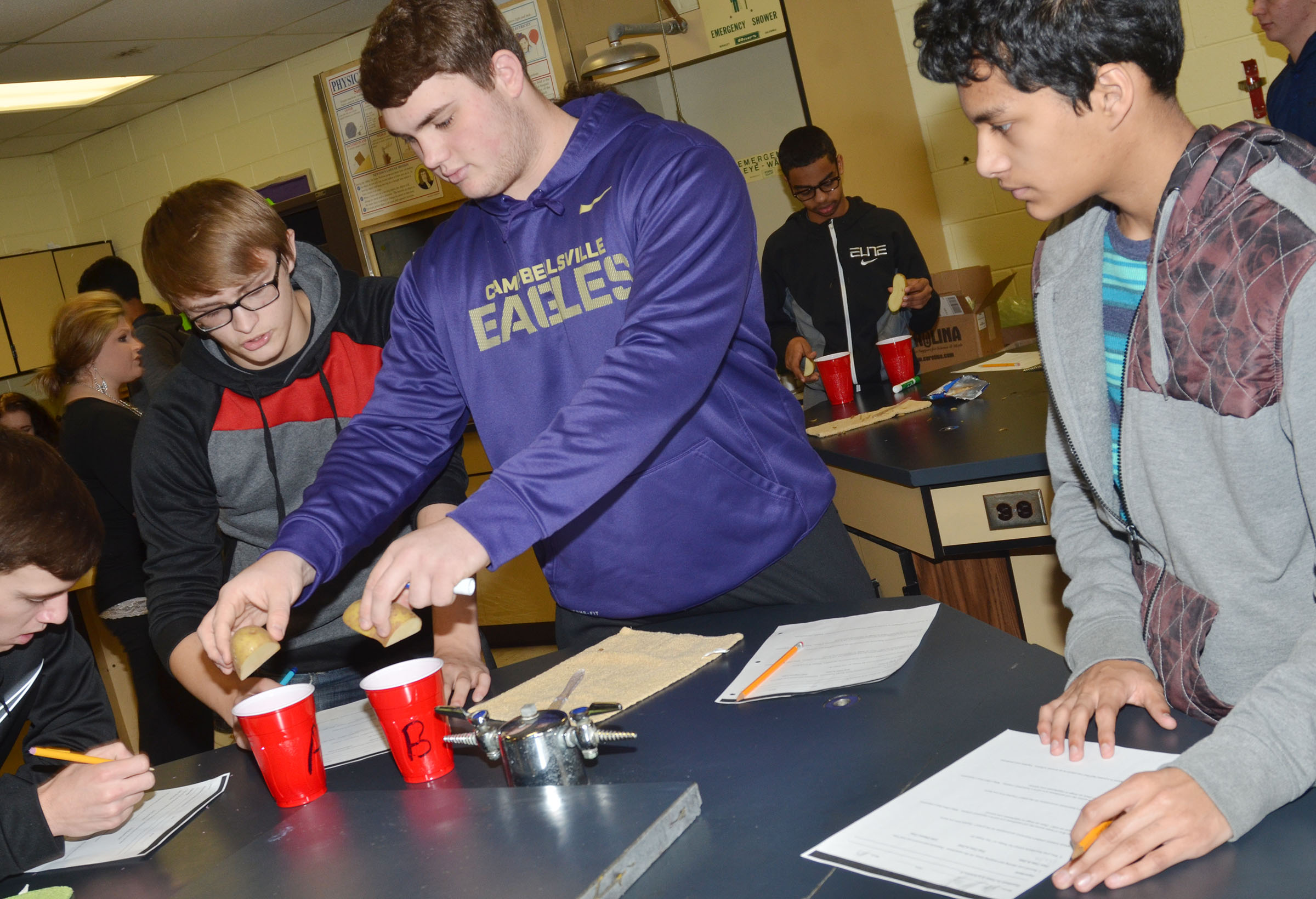 CHS sophomore Lane Bottoms drops his group's potatoes in the water and salt water mixtures.