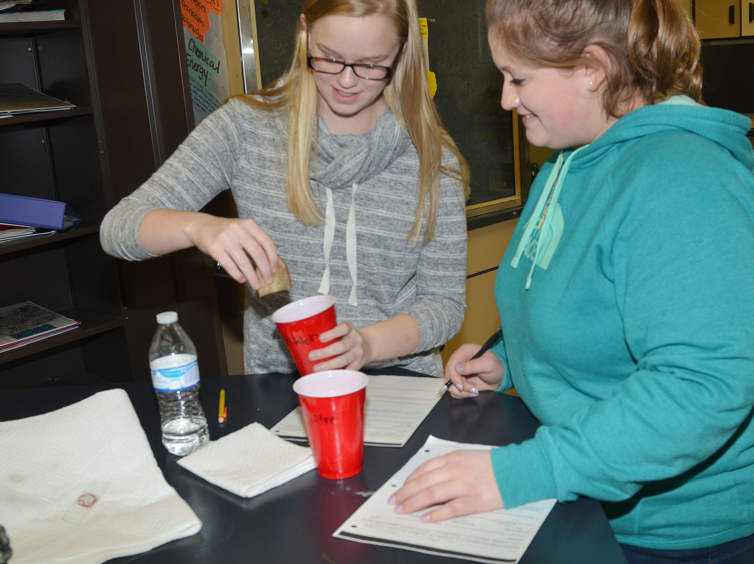 CHS freshmen Tahler Franklin, at left, and Aleah Knifley see how the osmosis process effected their potato.