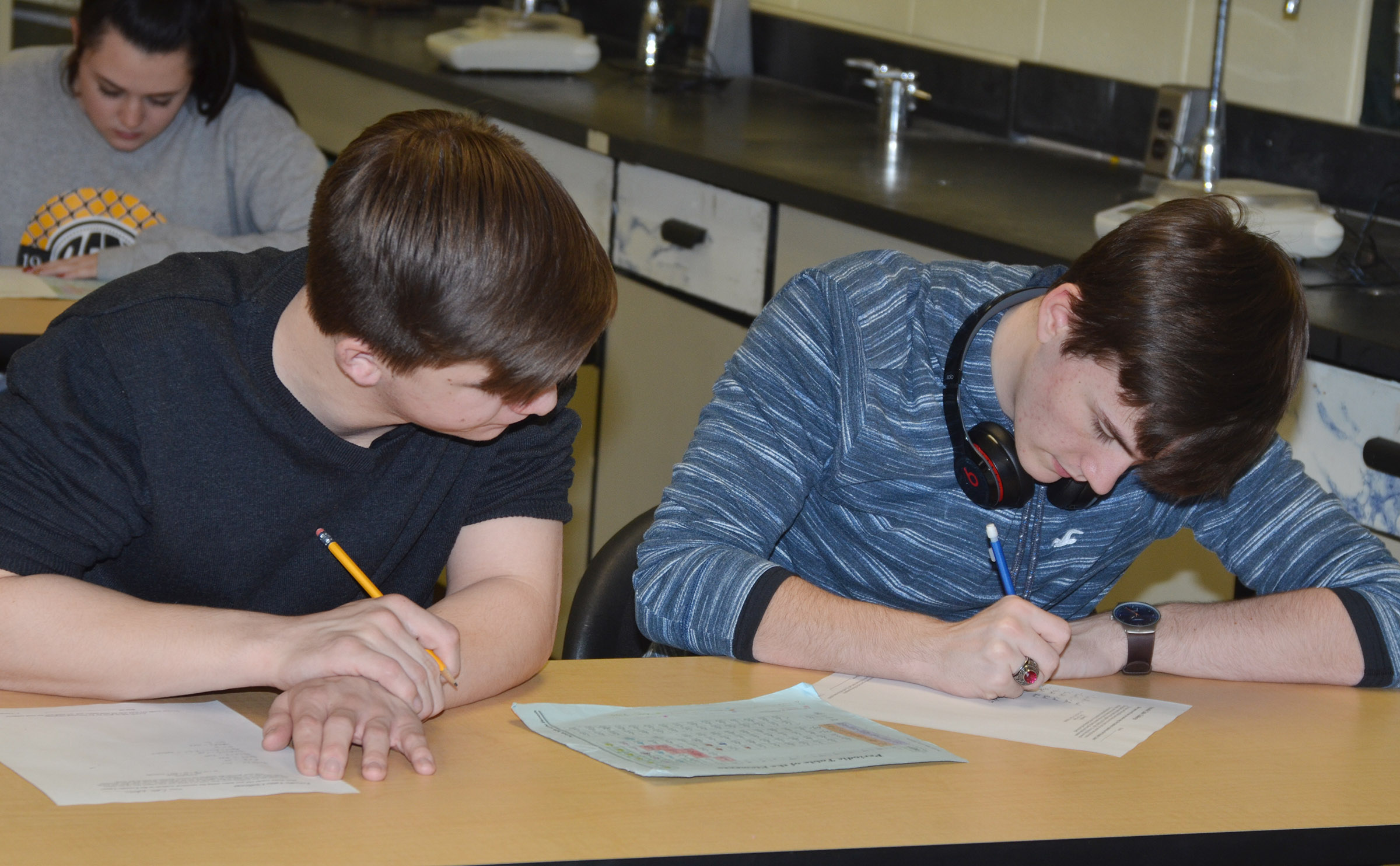 CHS juniors Cass Kidwell, at left, and Jackson Hunt see how many words they can spell using the symbols for elements on the periodic table.
