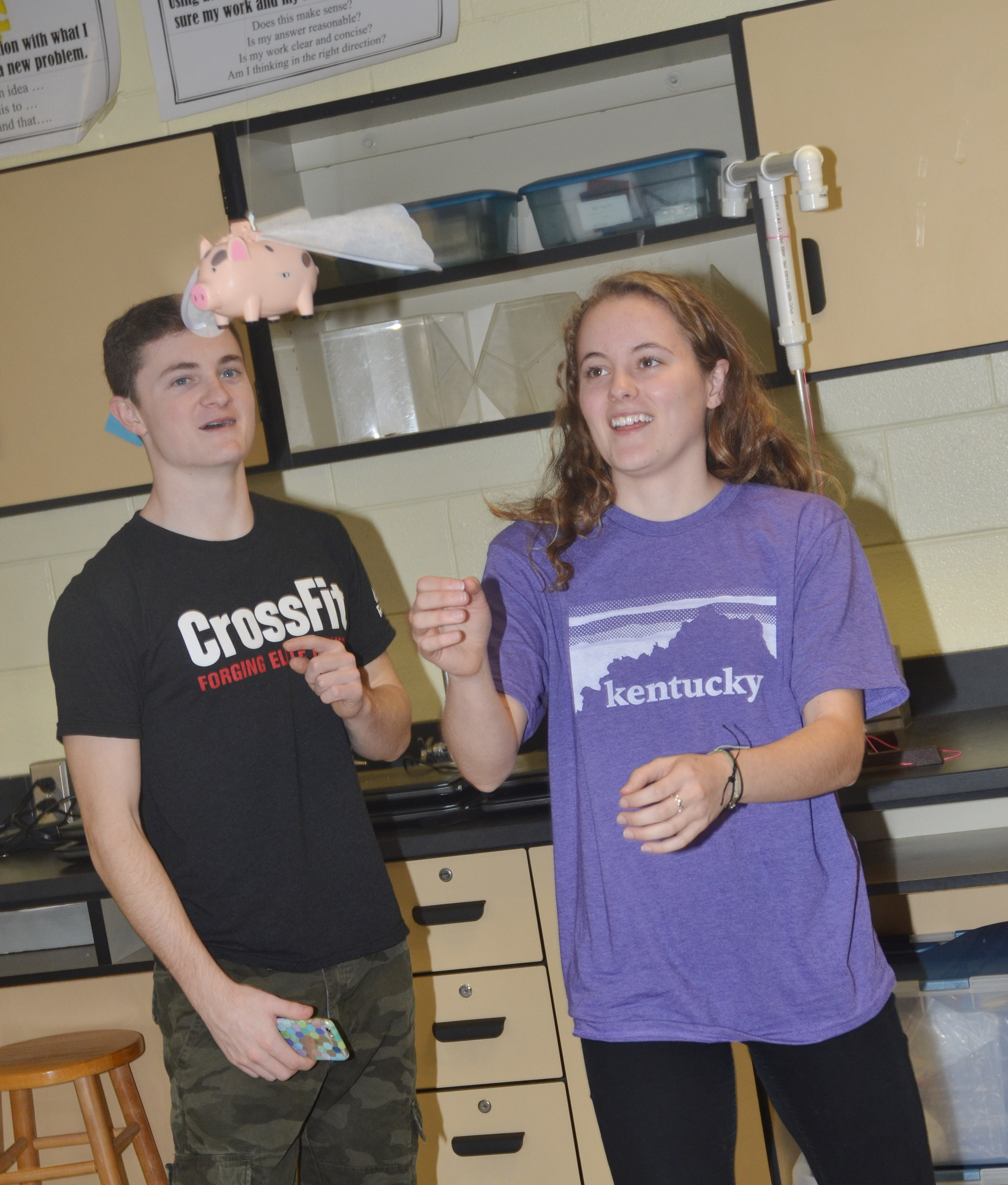 "CHS junior Bryce Richardson, at left, and Caroline McMahan watch as their pig ""flies."""
