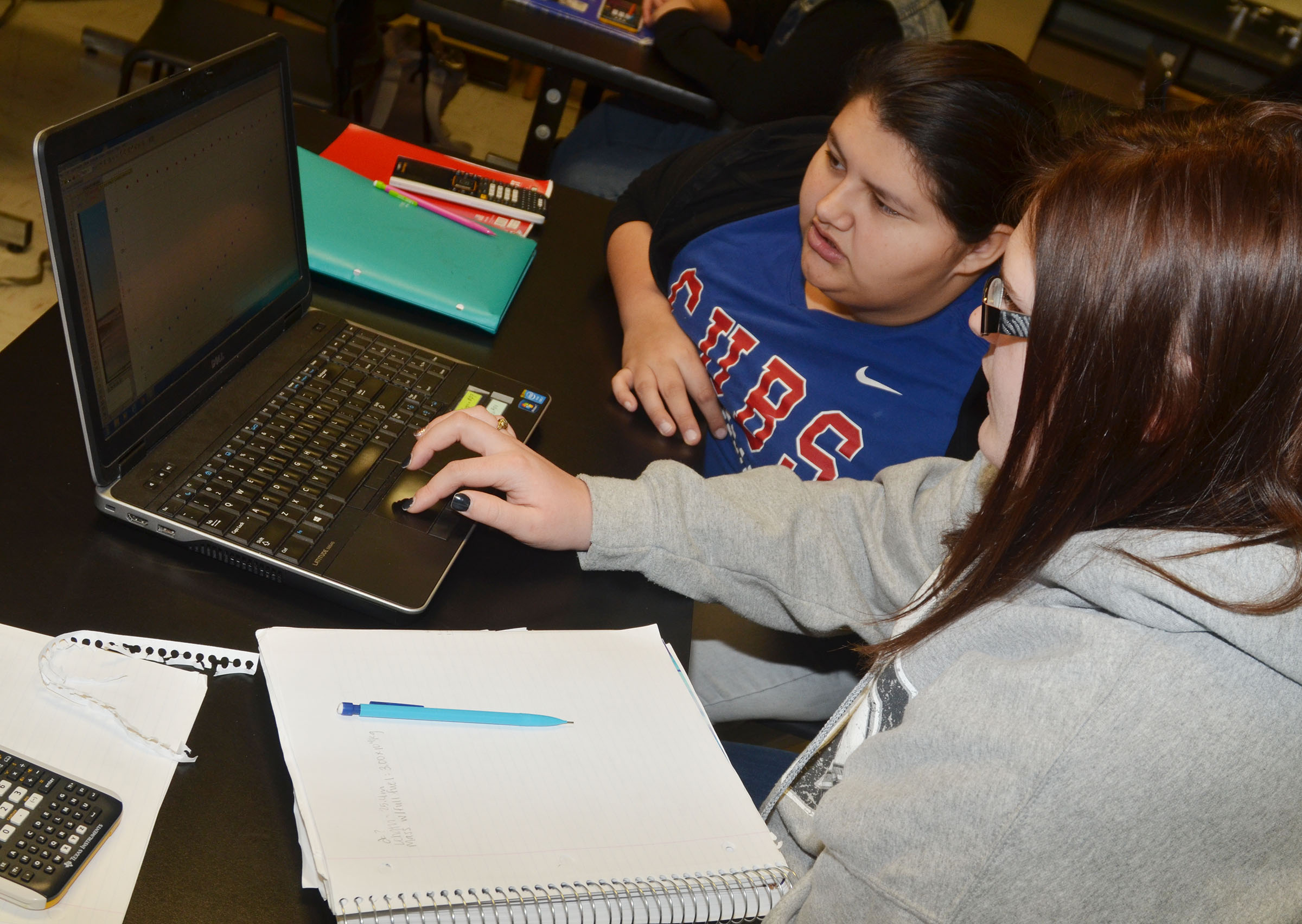 CHS seniors Laura May Gutierrez, at left, and Vera Brown analyze data with the Logger Pro software.