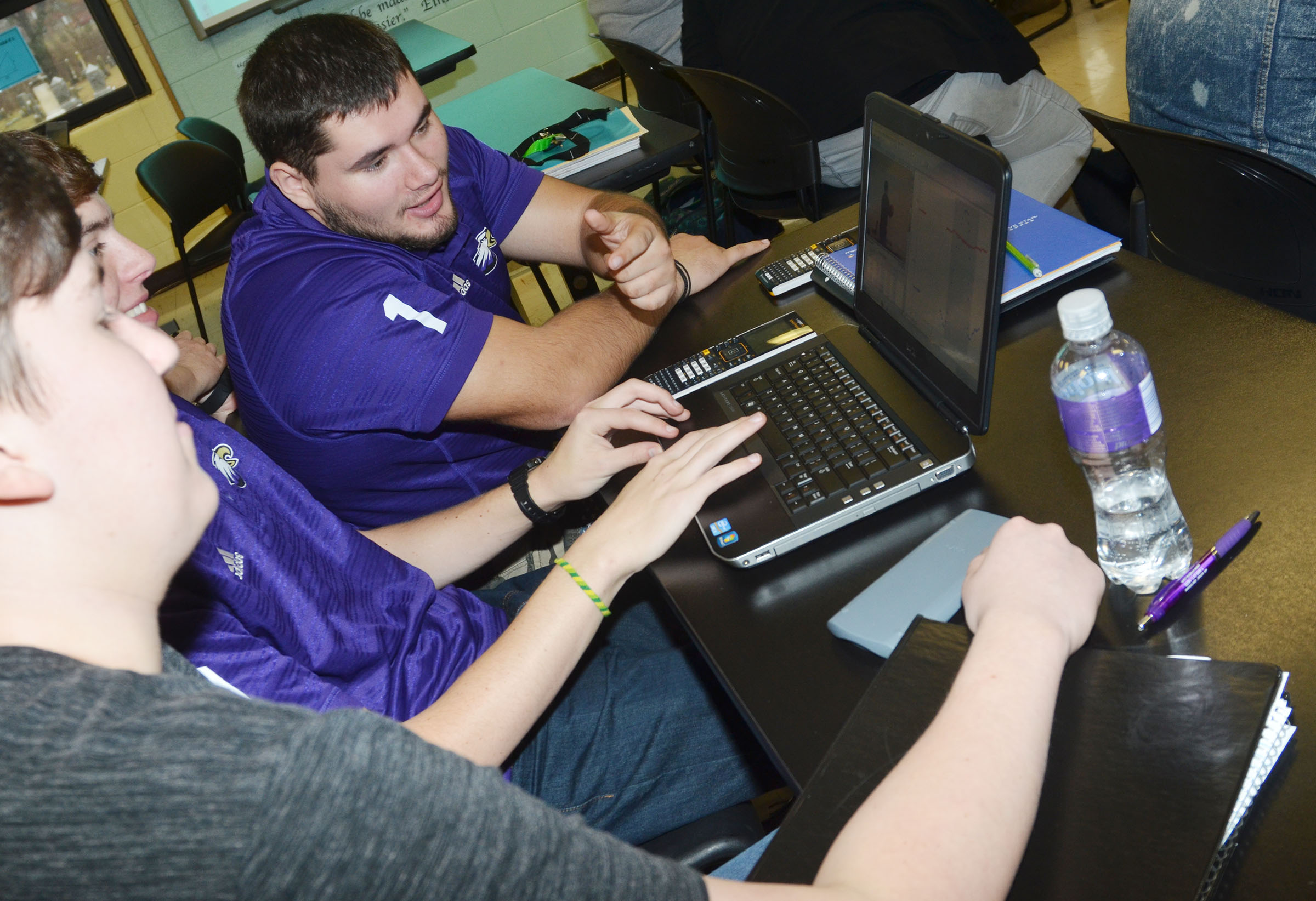 CHS seniors, from left, Zack Settle, Murphy Lamb and Logan Brown use the Logger Pro software.