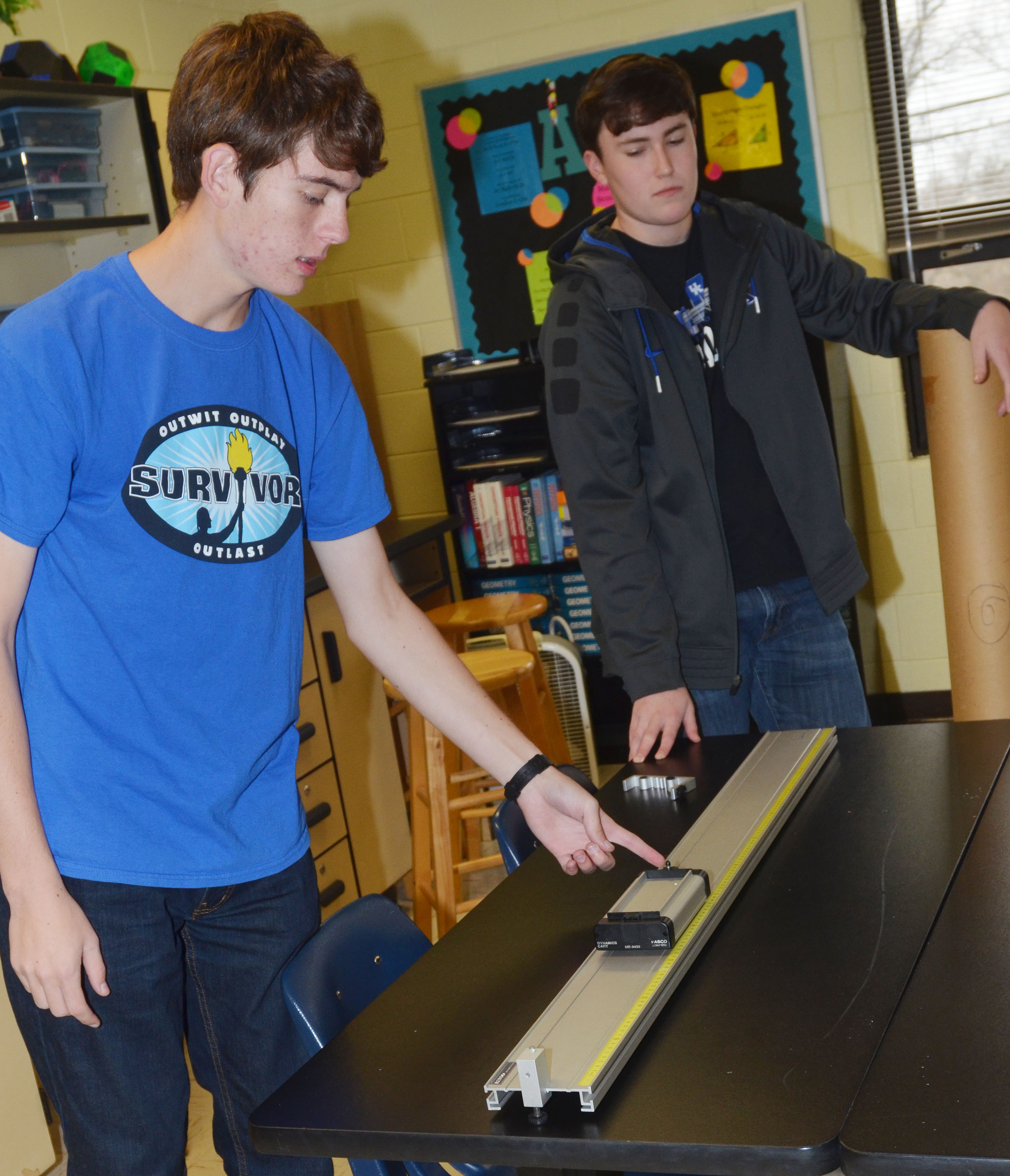 CHS seniors Murphy Lamb, at left, and Zack Settle perform their momentum lab experiment.