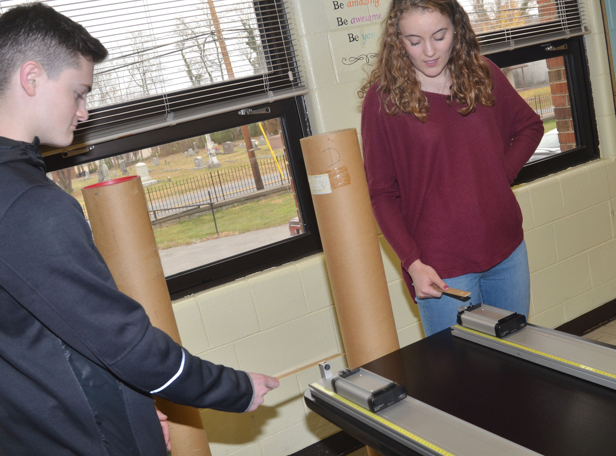 CHS junior Bryce Richardson, at left, and senior Caroline McMahan see how much momentum is needed for their carts to travel at the same speed.