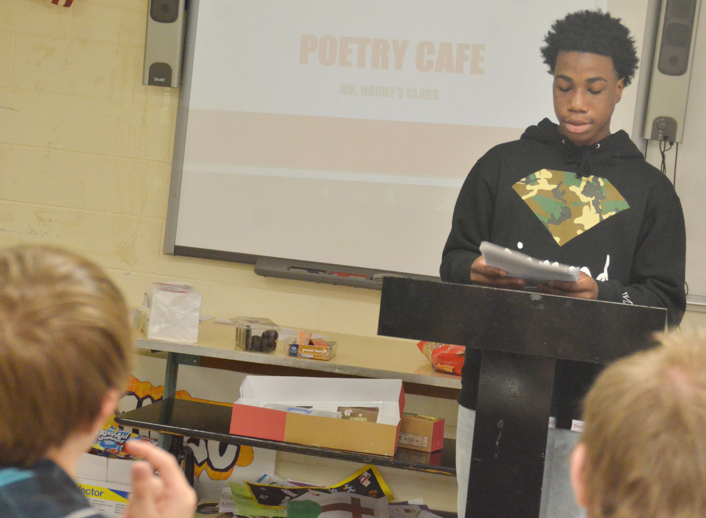 CHS freshman Malachi Corley reads his poetry.