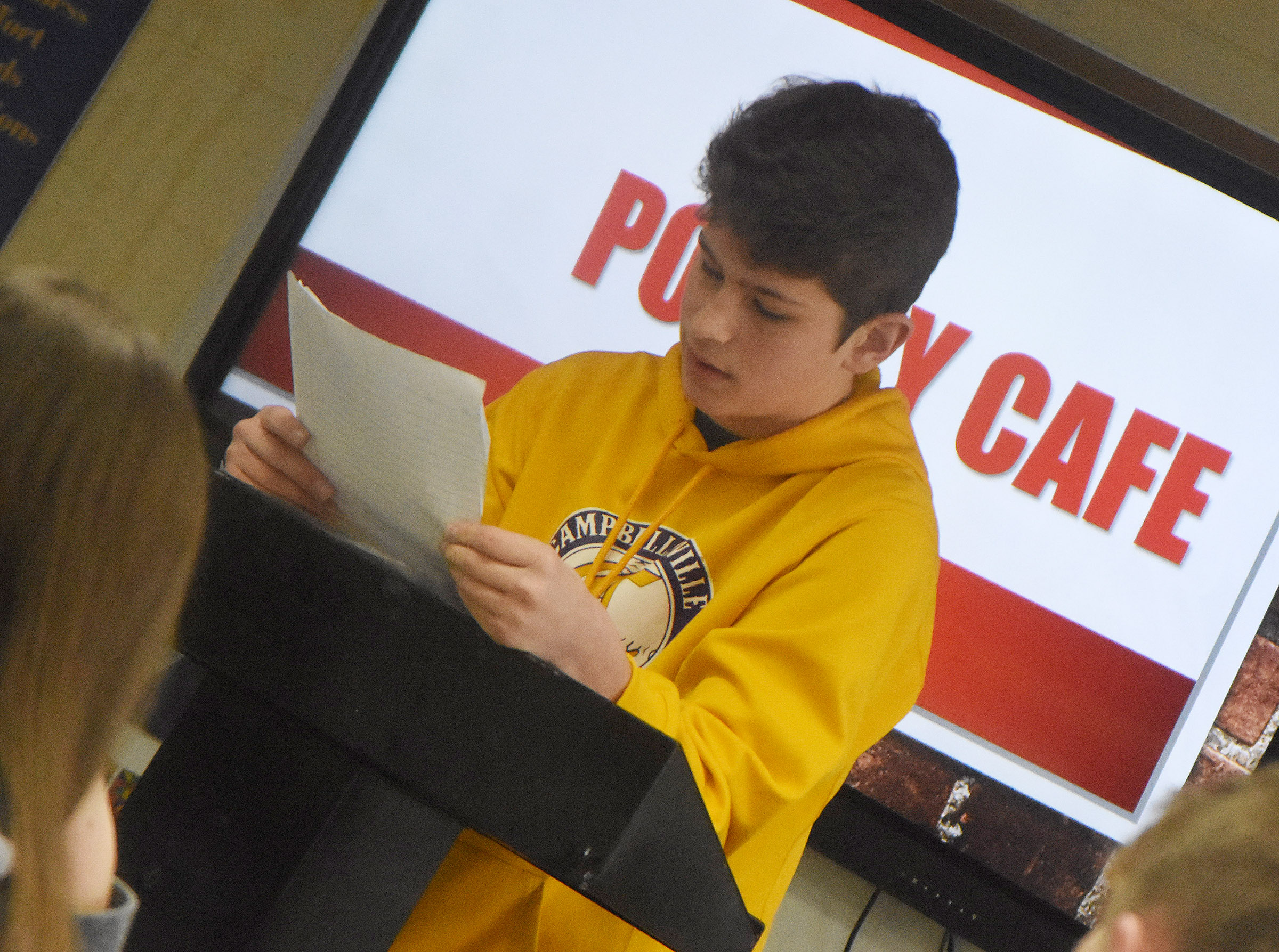 Campbellsville Middle School eighth-grader Weston Mattingly reads his poetry.