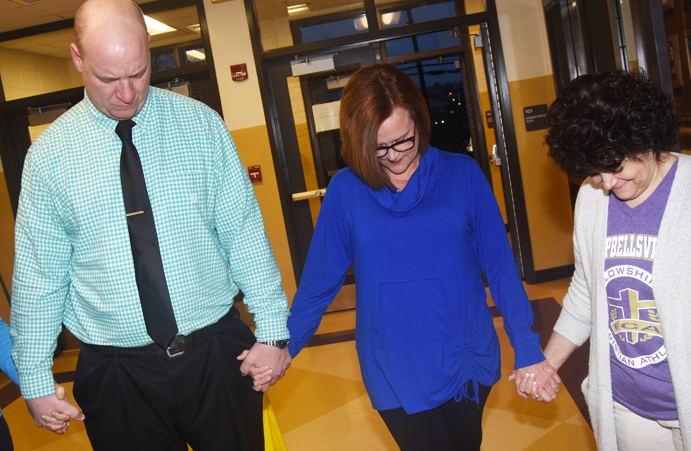 CHS hosted a prayer circle on Thursday, March 1. From left are CHS Principal David Petett and teachers Mary Jo Hazel and Cheryl Dicken.