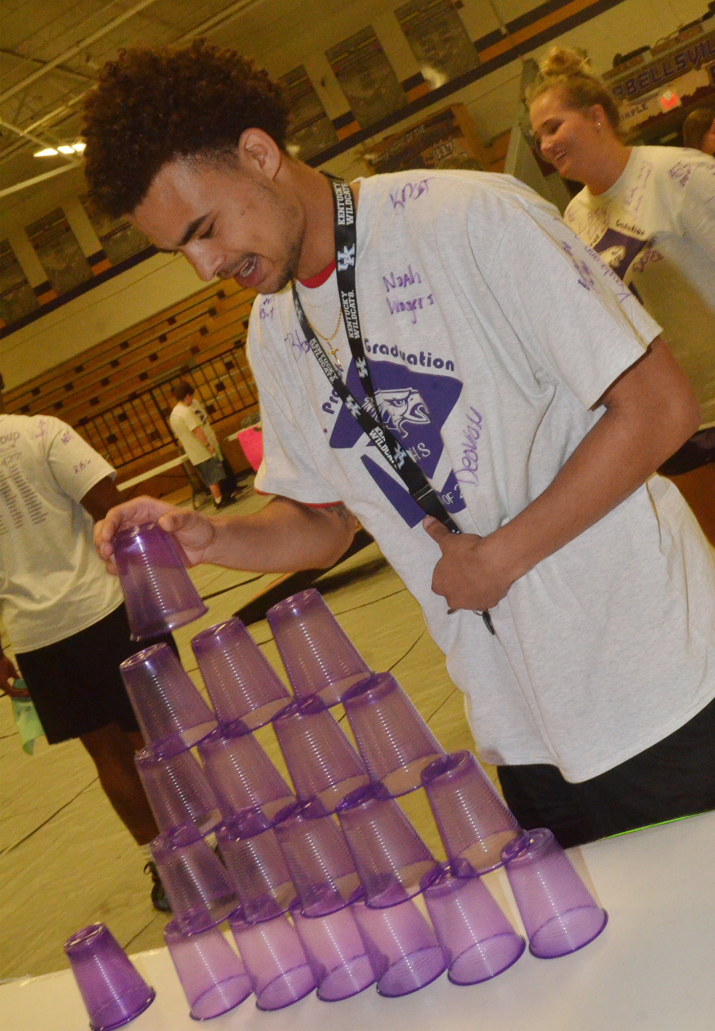 CHS senior Arick Groves plays a cup stacking game.