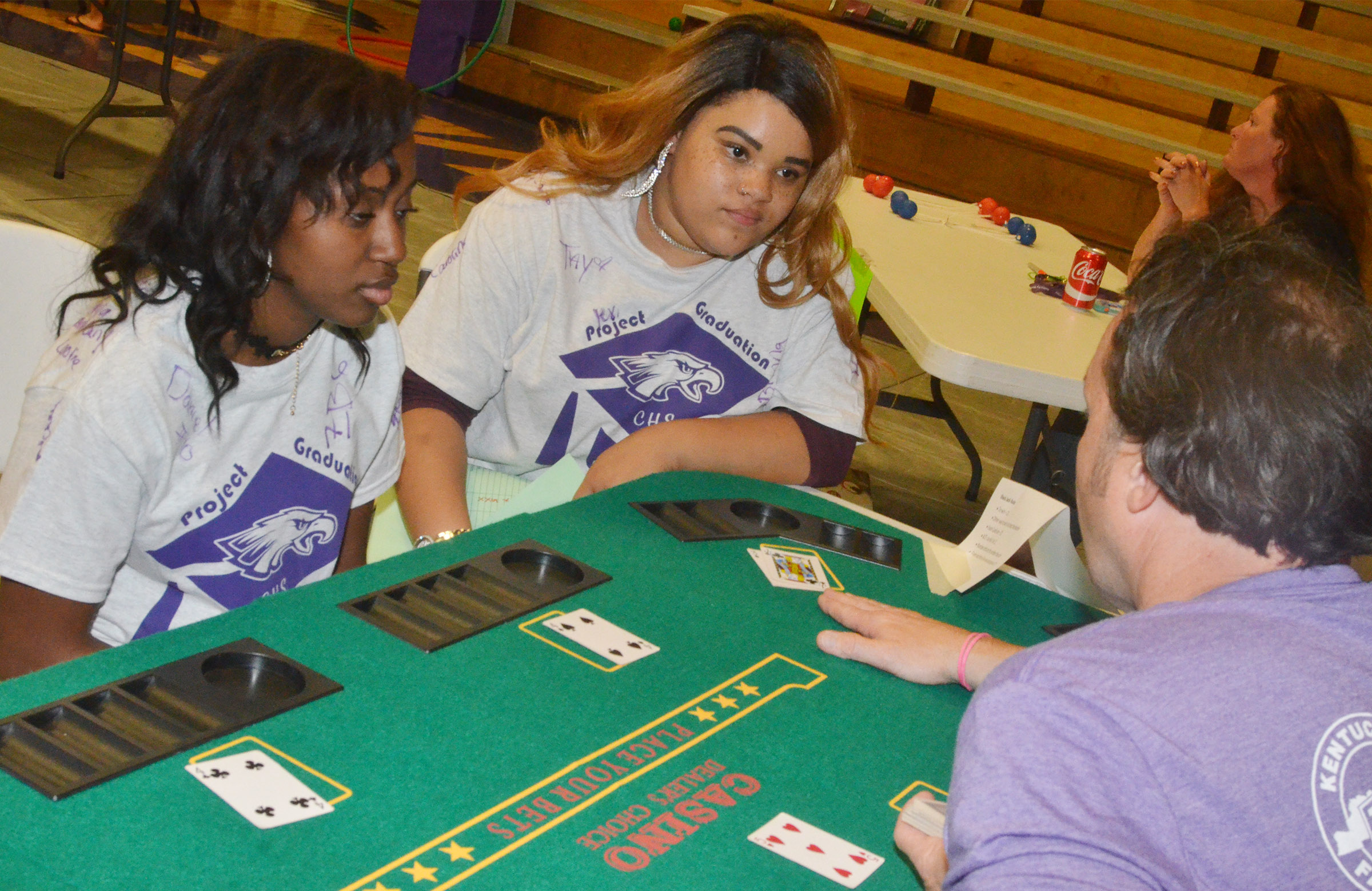 CHS seniors Latavia Shively, at left, and Deovion Owens play blackjack.