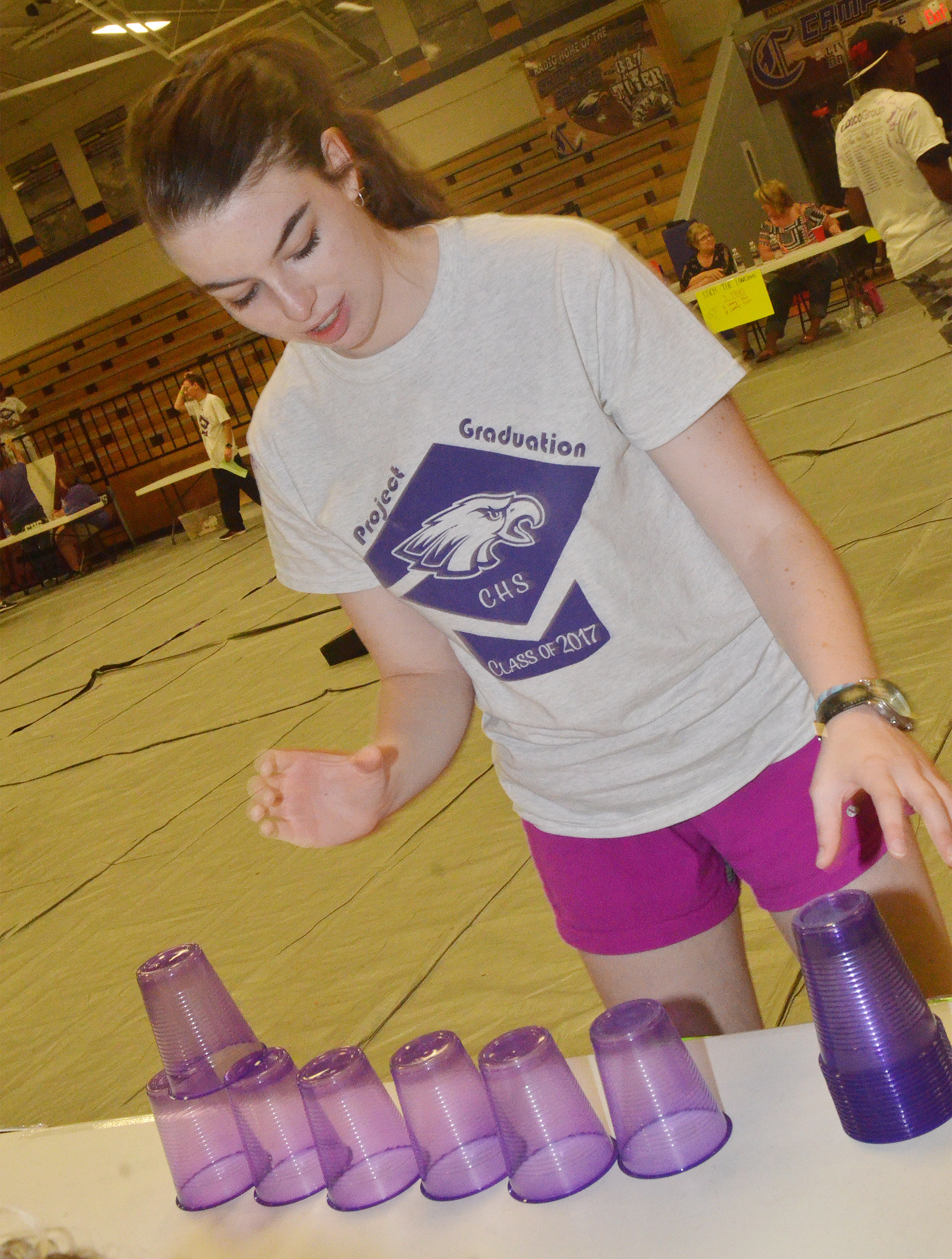CHS senior Laura Lamb plays a cup stacking game.