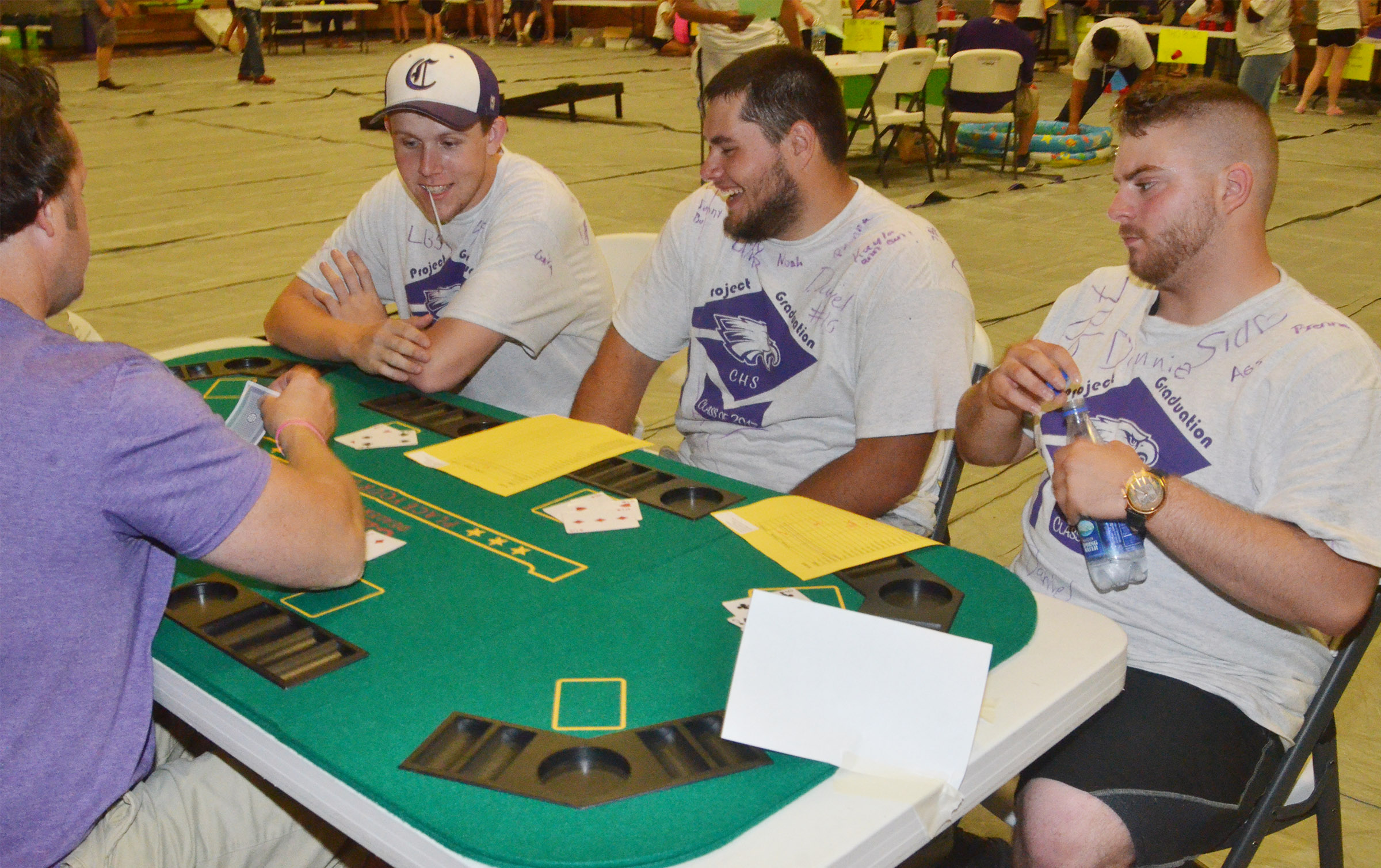 From left, CHS seniors Jared Brewster, Logan Brown and Jon Tanner Coppage play blackjack.