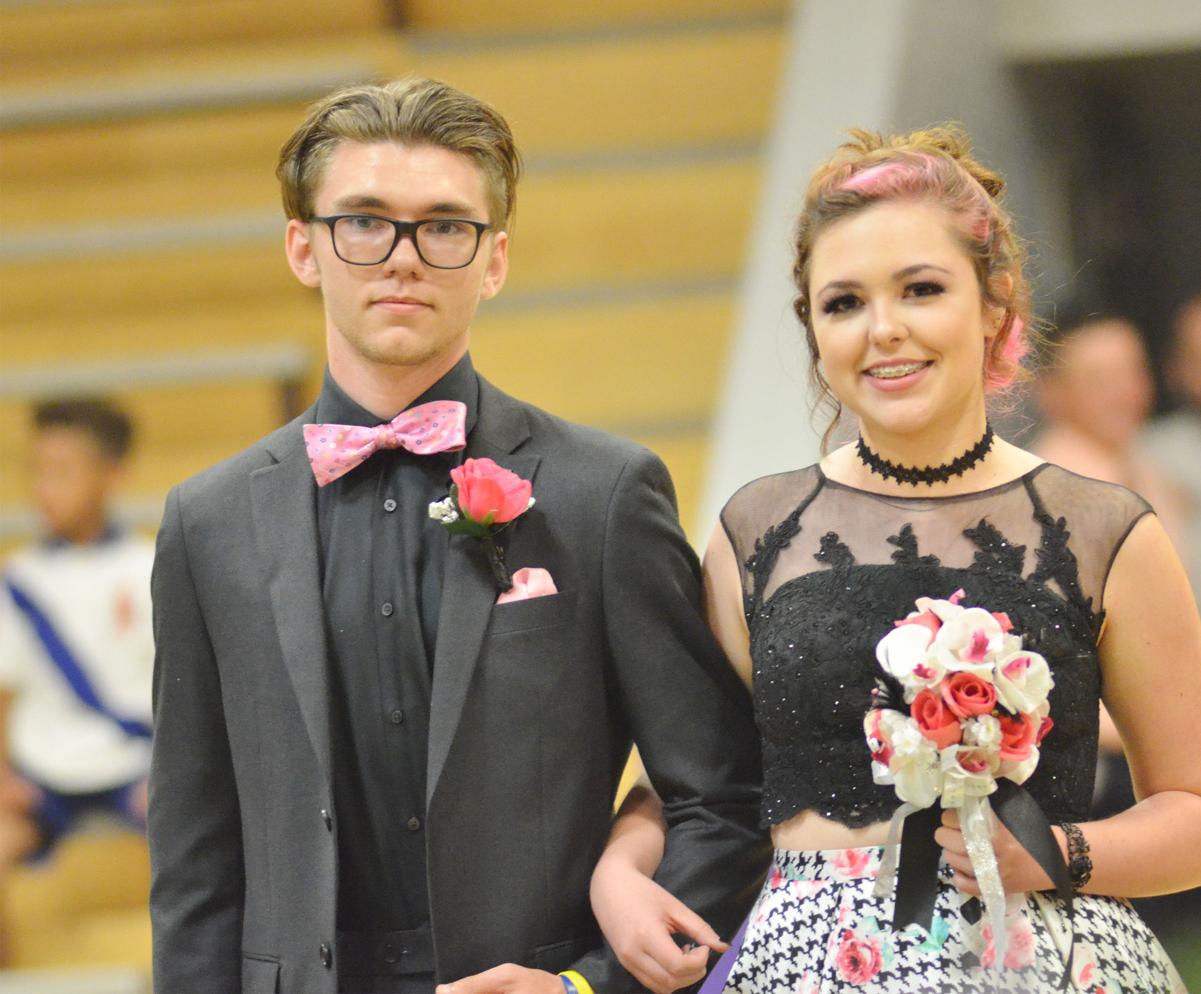 CHS junior Christian Berry and his date Jesslynne Mann smile at prom walk.