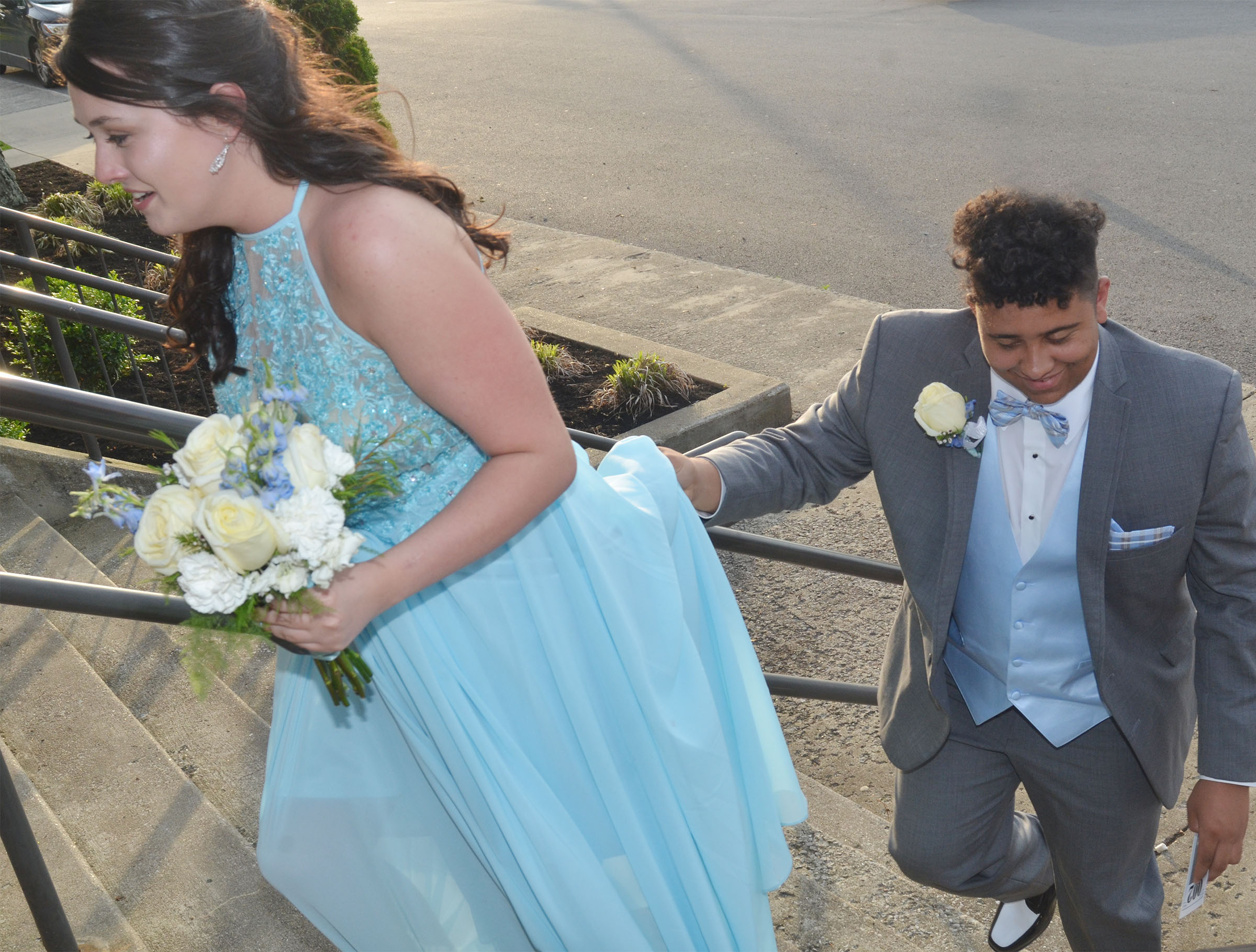 CHS junior Adrian Cravens helps junior Missy Vanorder walk up the steps.