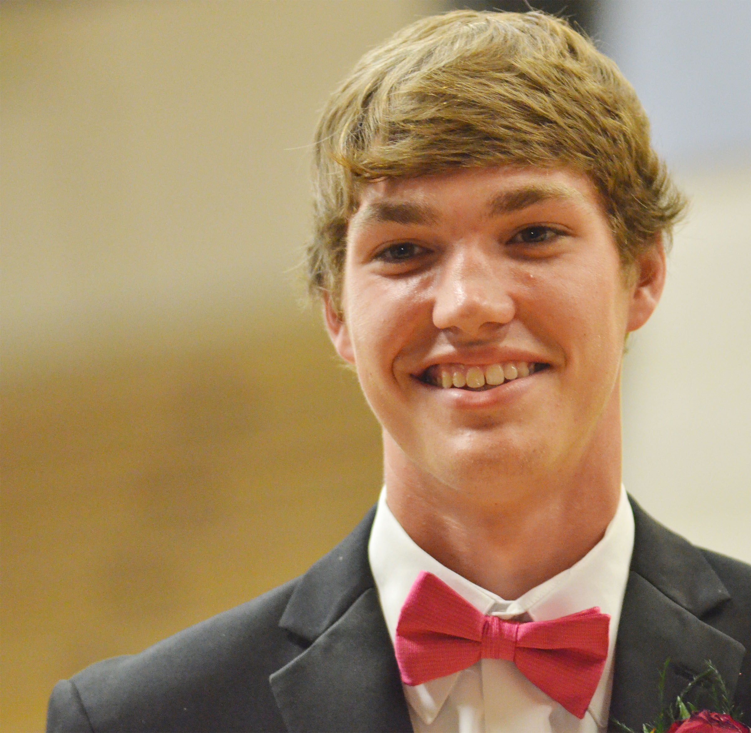 CHS senior Zack Bottoms smiles at prom walk.