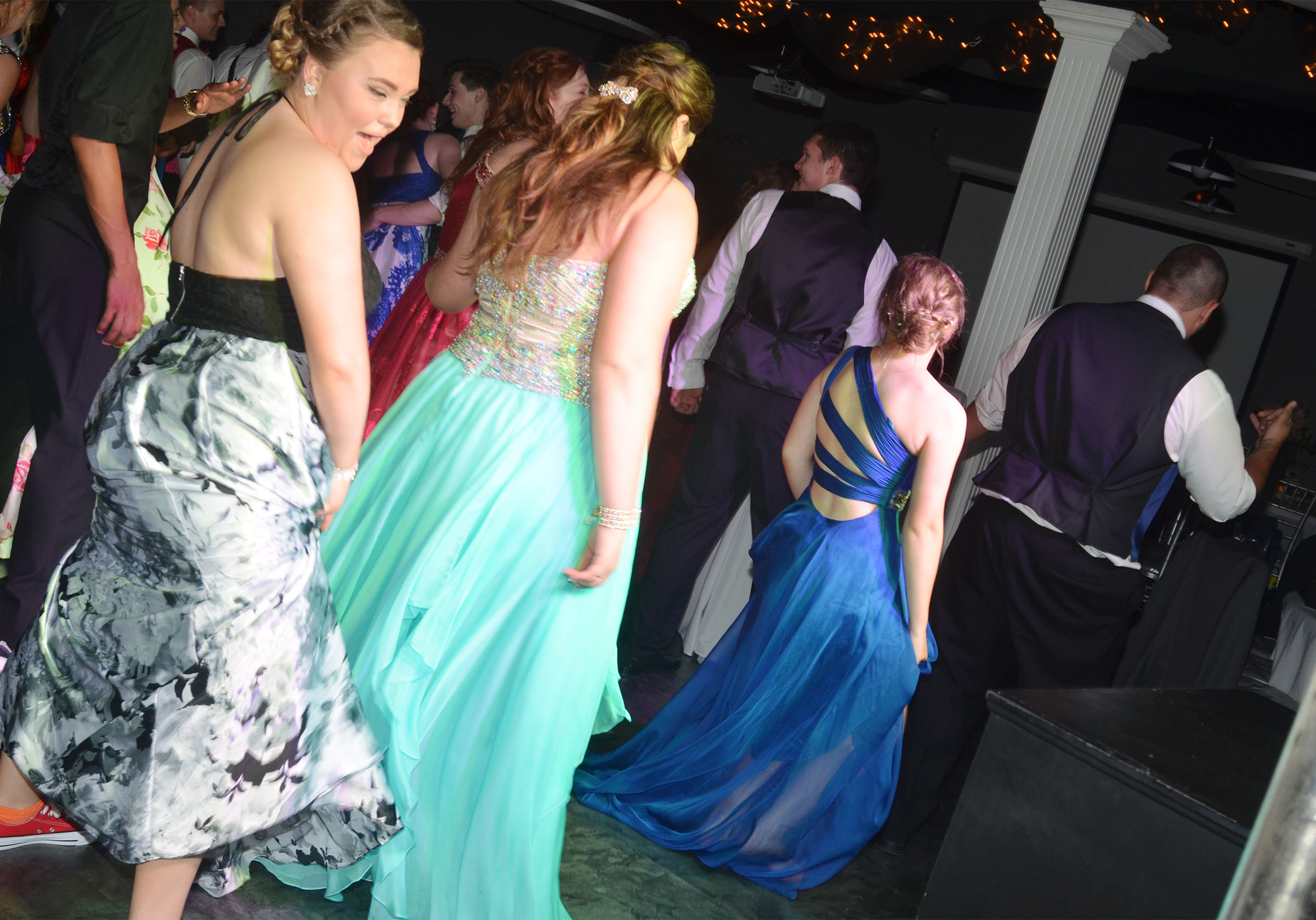 CHS junior Haley Fitch, at left, and her classmates dance at prom.