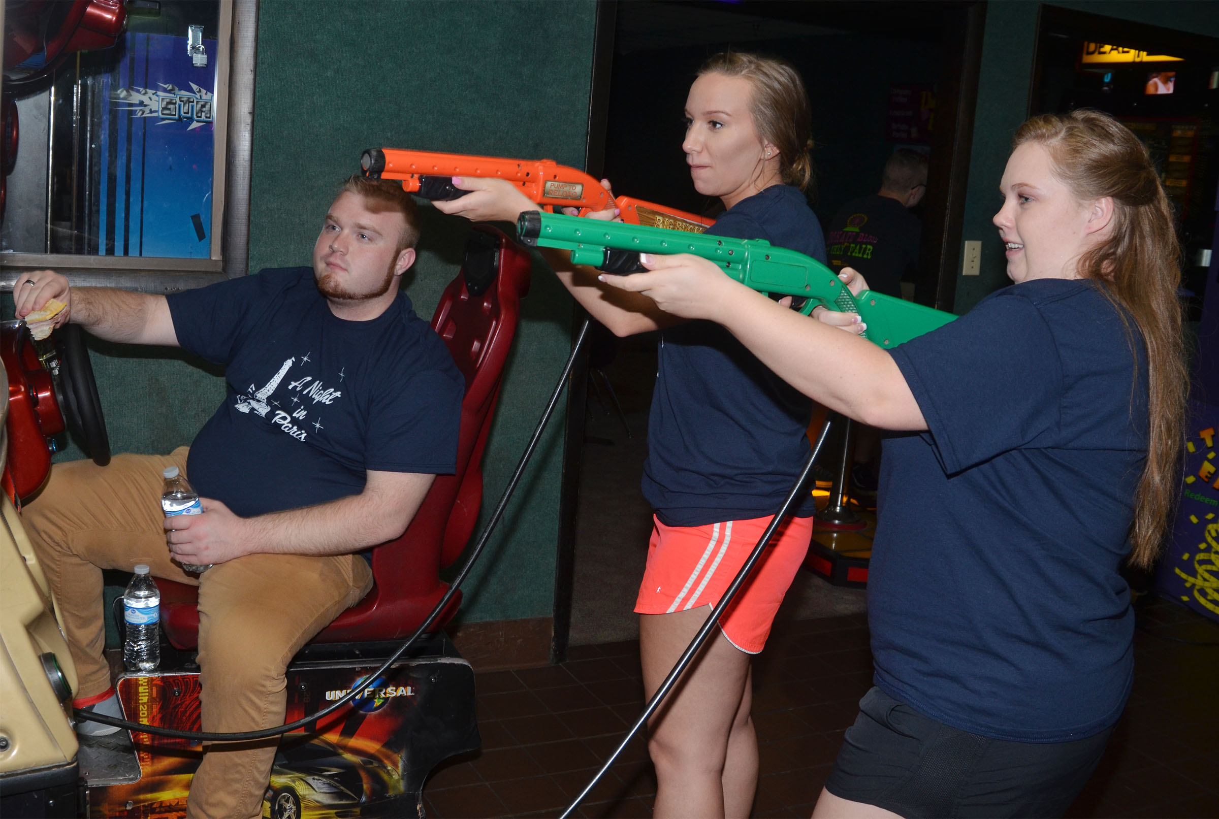 CHS junior Madison Dial, center, and senior Madison Lewis play games at prom breakfast. At left is Dial's date Jared Campbell.