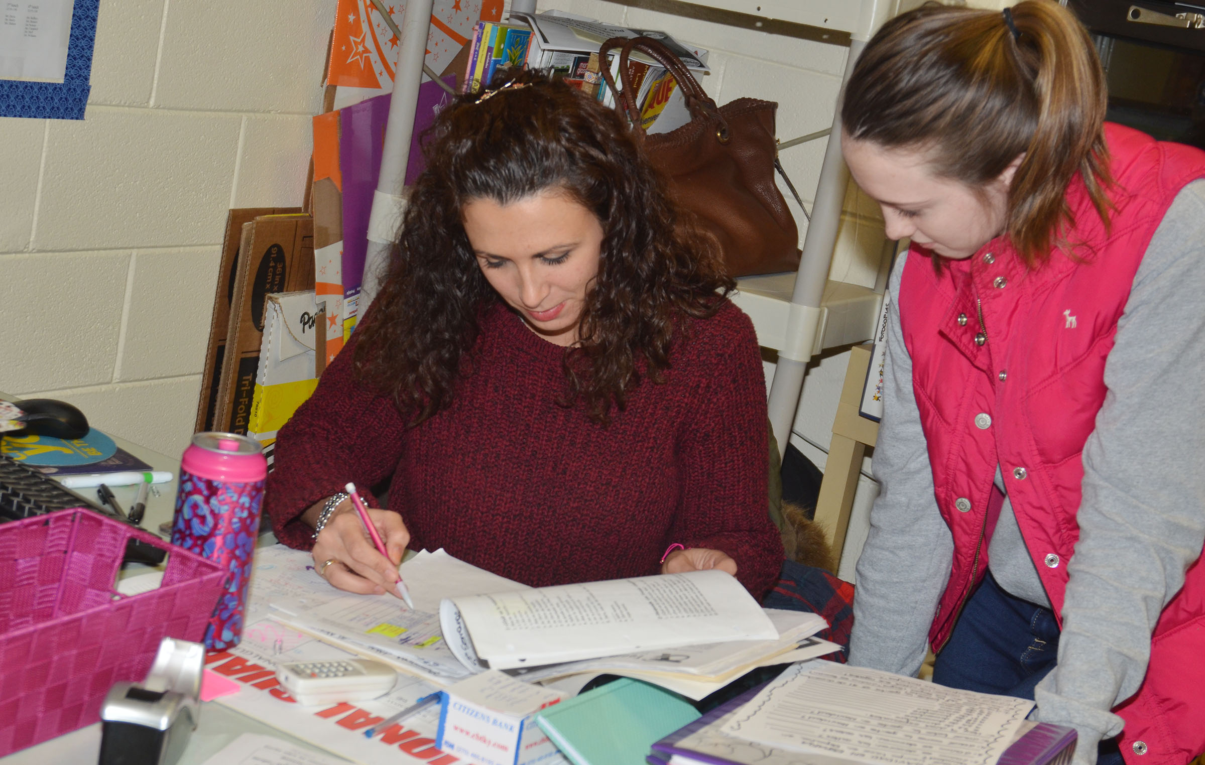 CHS Spanish teacher Leticia Lopez-Rioja talks with sophomore Caleigh Bright about her grades.