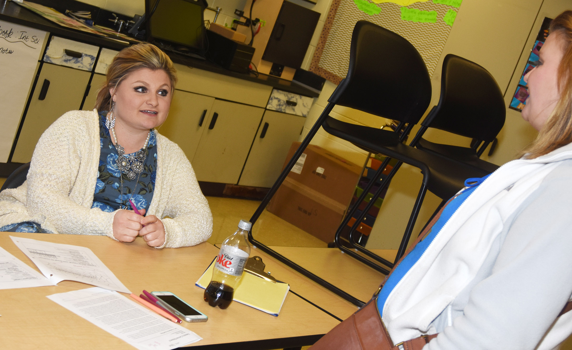 CHS teacher Lauren Bennett meets with parent and Campbellsville Elementary School teacher Tammy Hash.