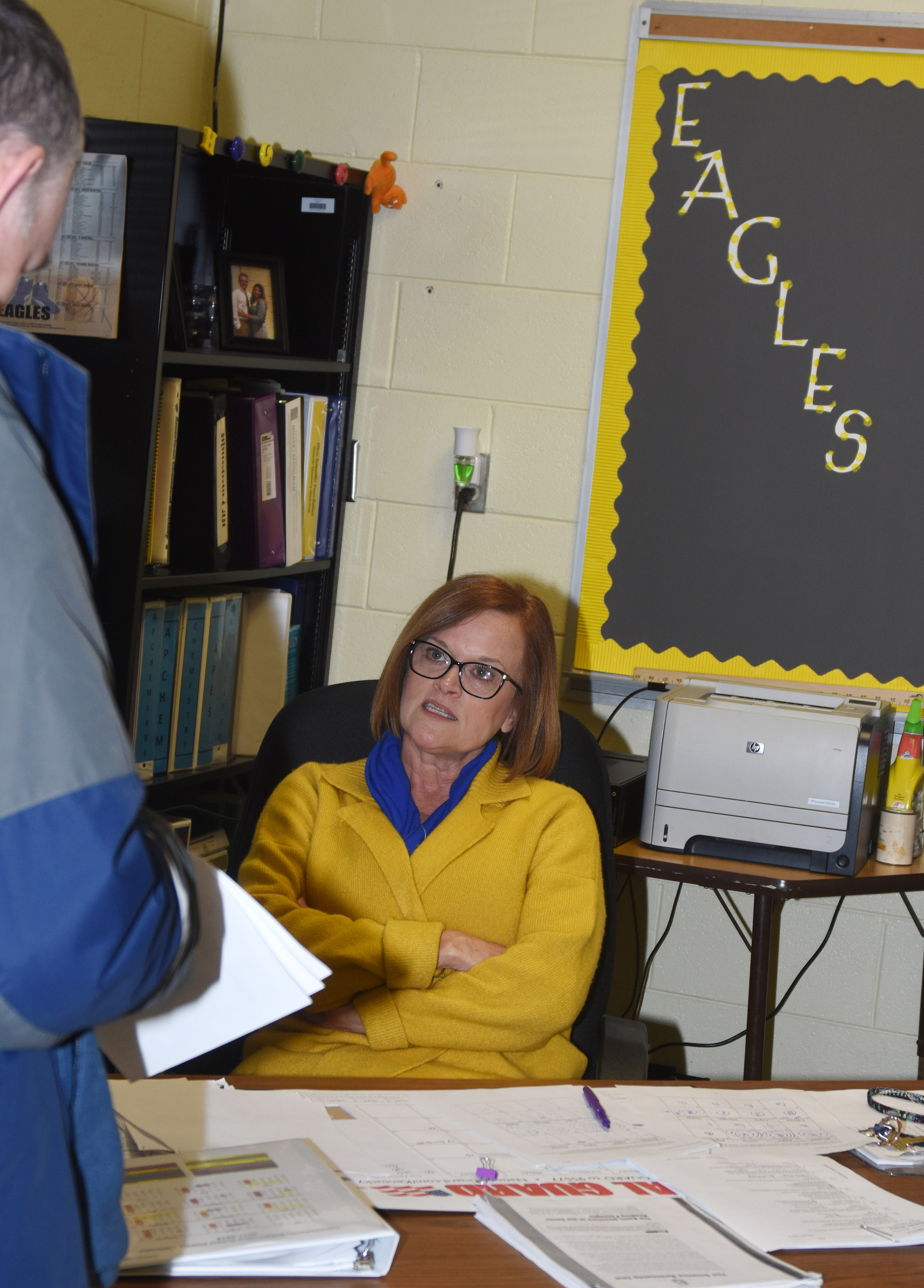 CHS teacher Mary Jo Hazel talks with a parent.