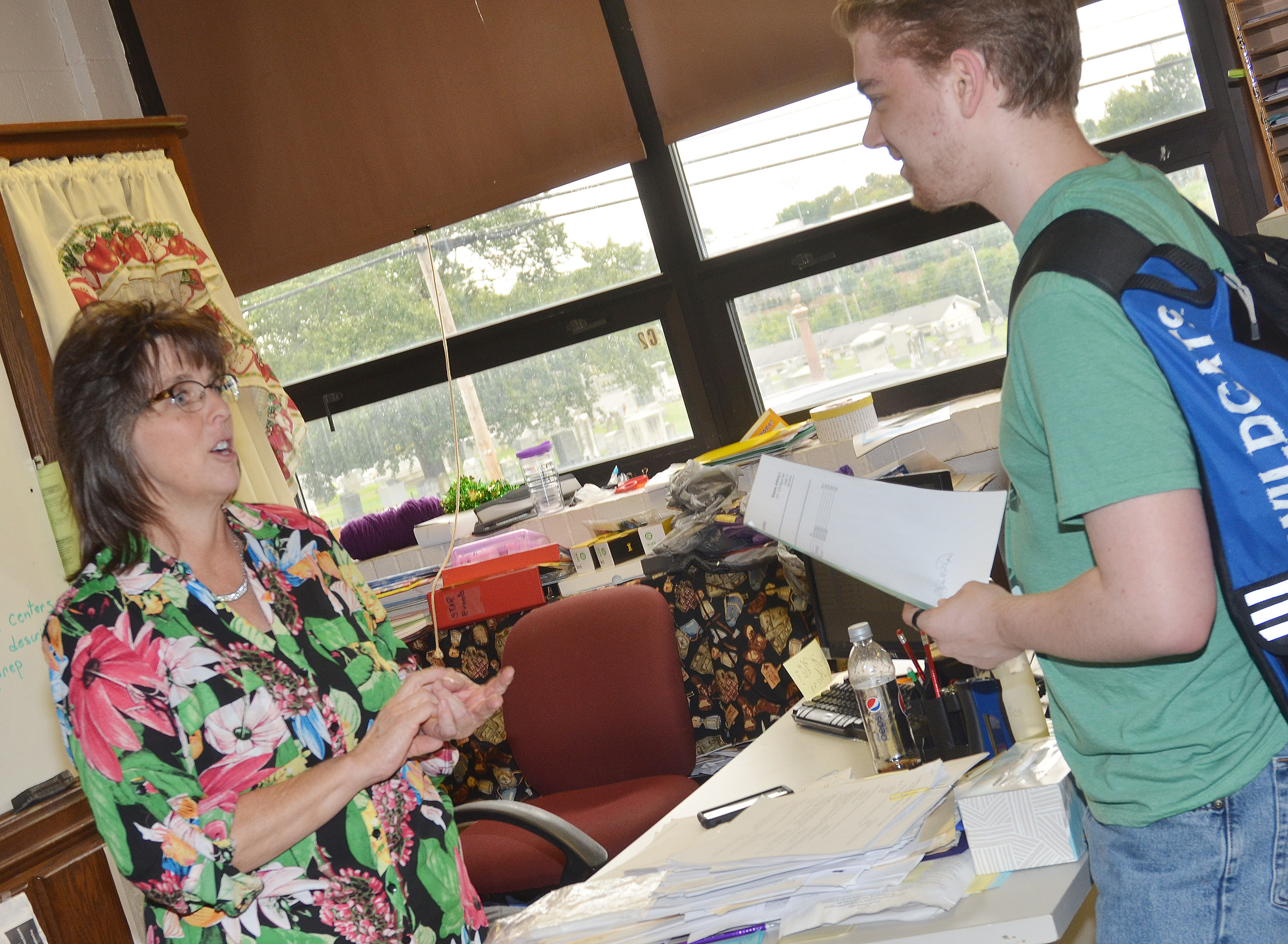 CHS teacher Deanna Campbell talks with sophomore Anthony Shipione.