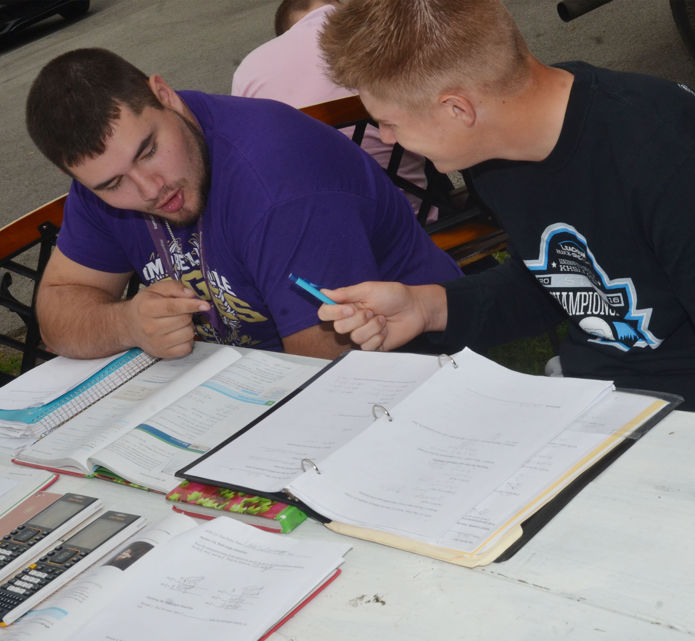 CHS senior Logan Brown, at left, and junior Alex Doss talk about their homework while having class outside.
