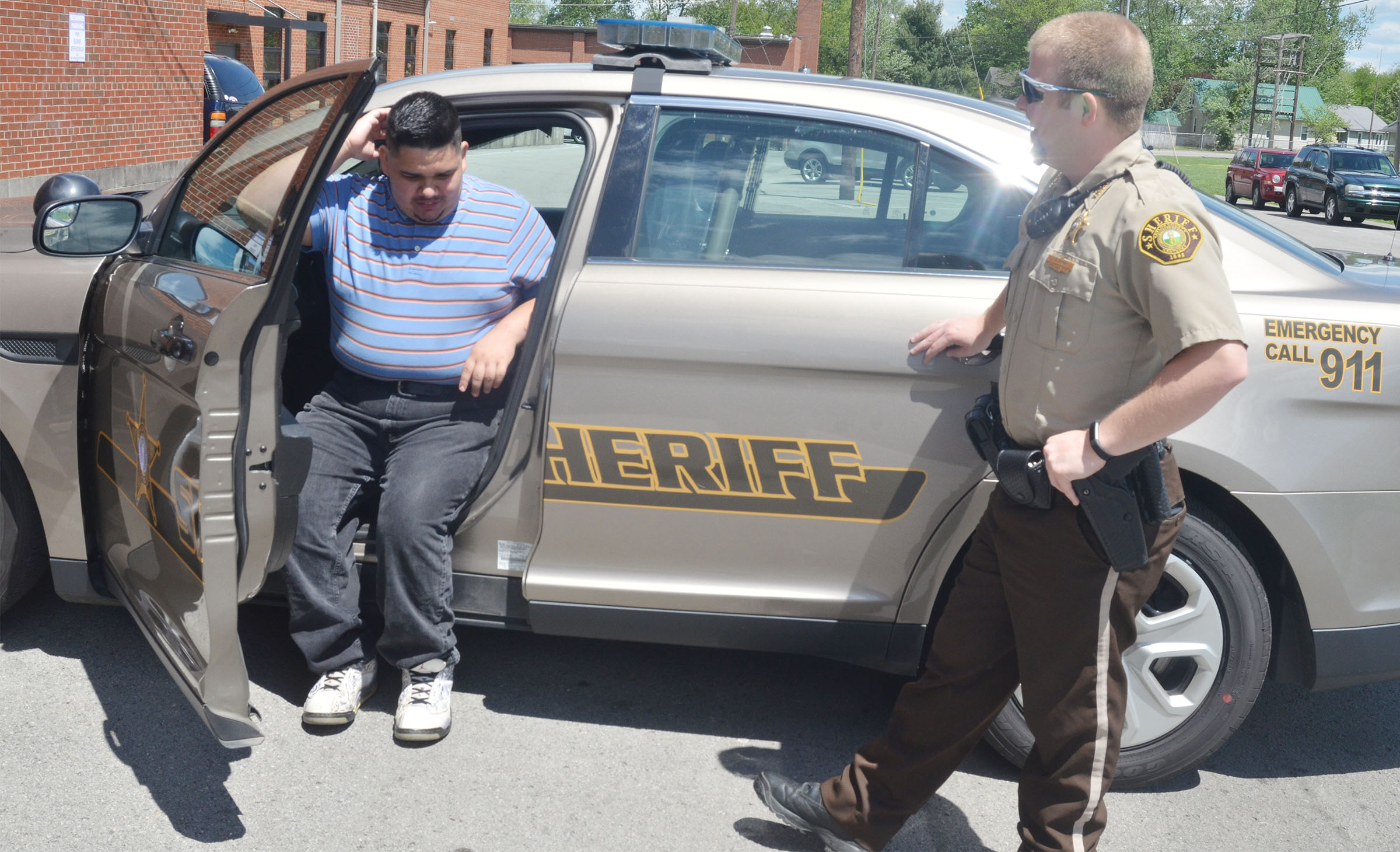 CHS senior Robert Tungate sits in Taylor County Sheriff's Deputy Tyler Finn's sheriff's vehicle.