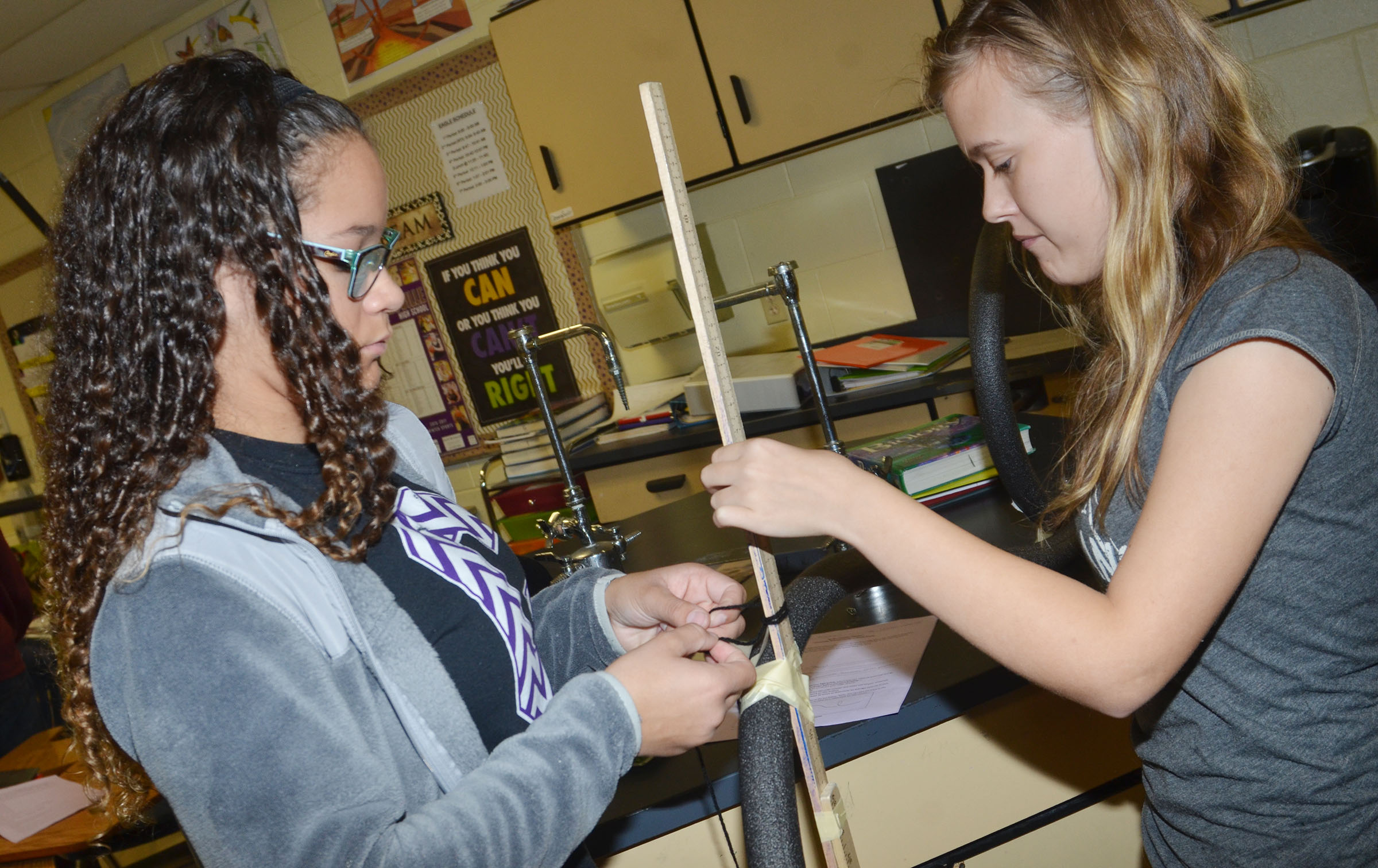 CHS freshmen Taliyah Hazelwood, at left, and Brittney Viers work together to build their roller coaster.