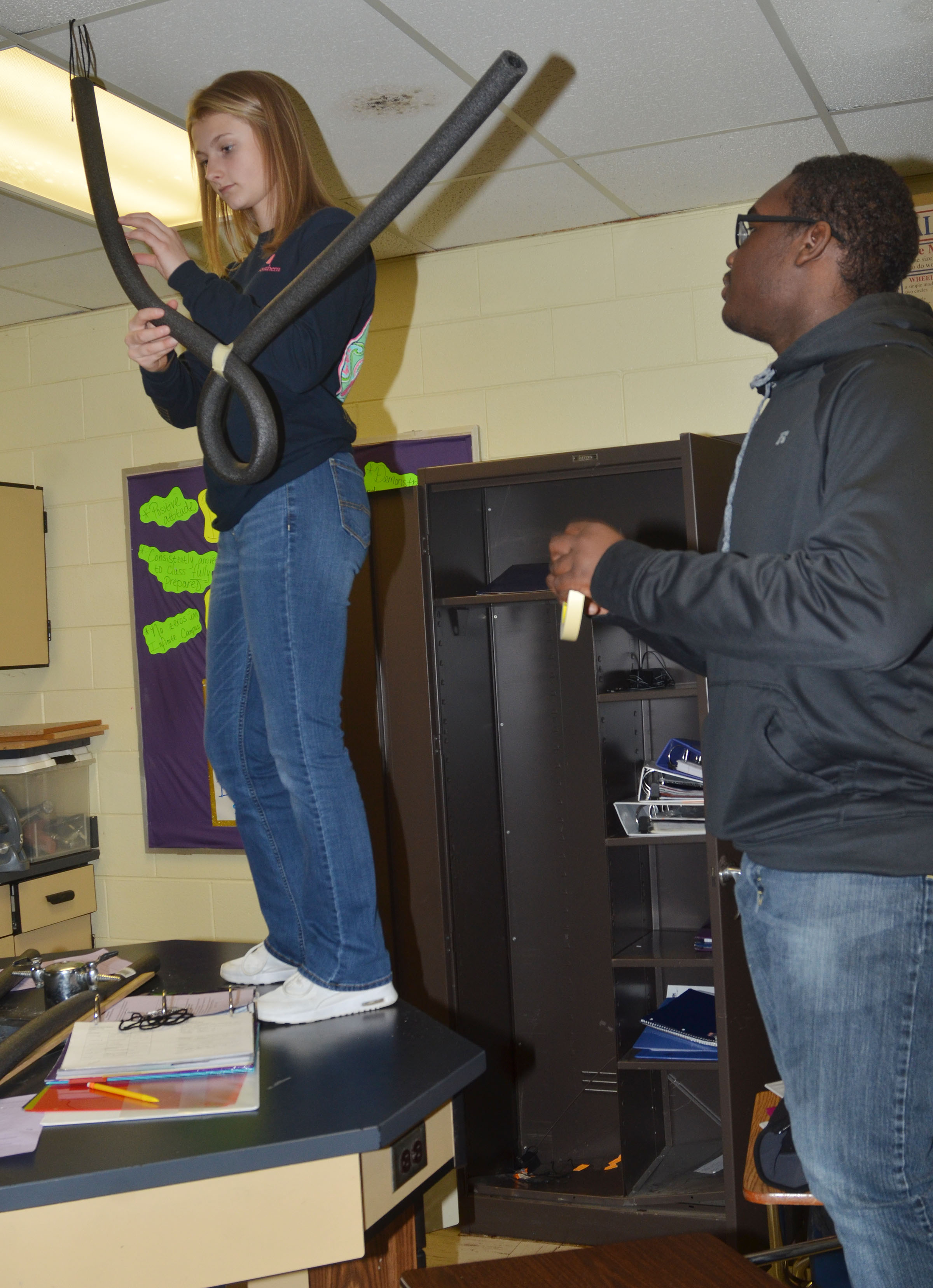 CHS freshmen Victoria Cox, at left, and Taekwon McCoy build their roller coaster.