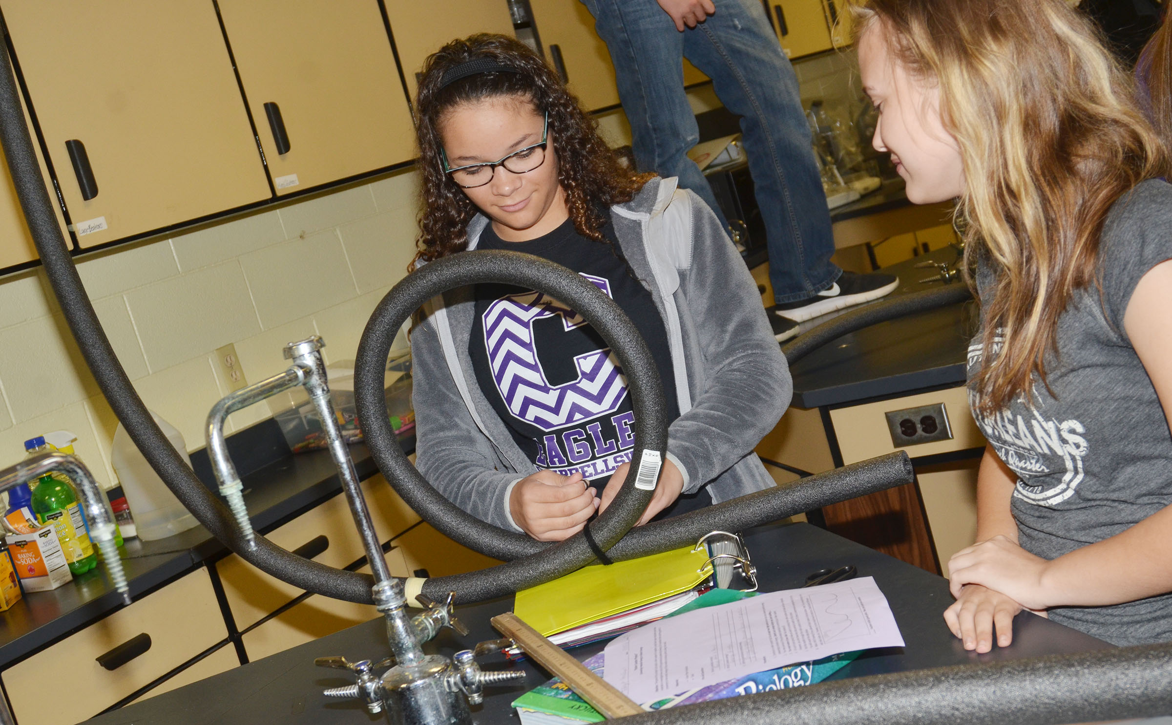 CHS freshman Taliyah Hazelwood, at left, and Brittney Viers work on their roller coaster.