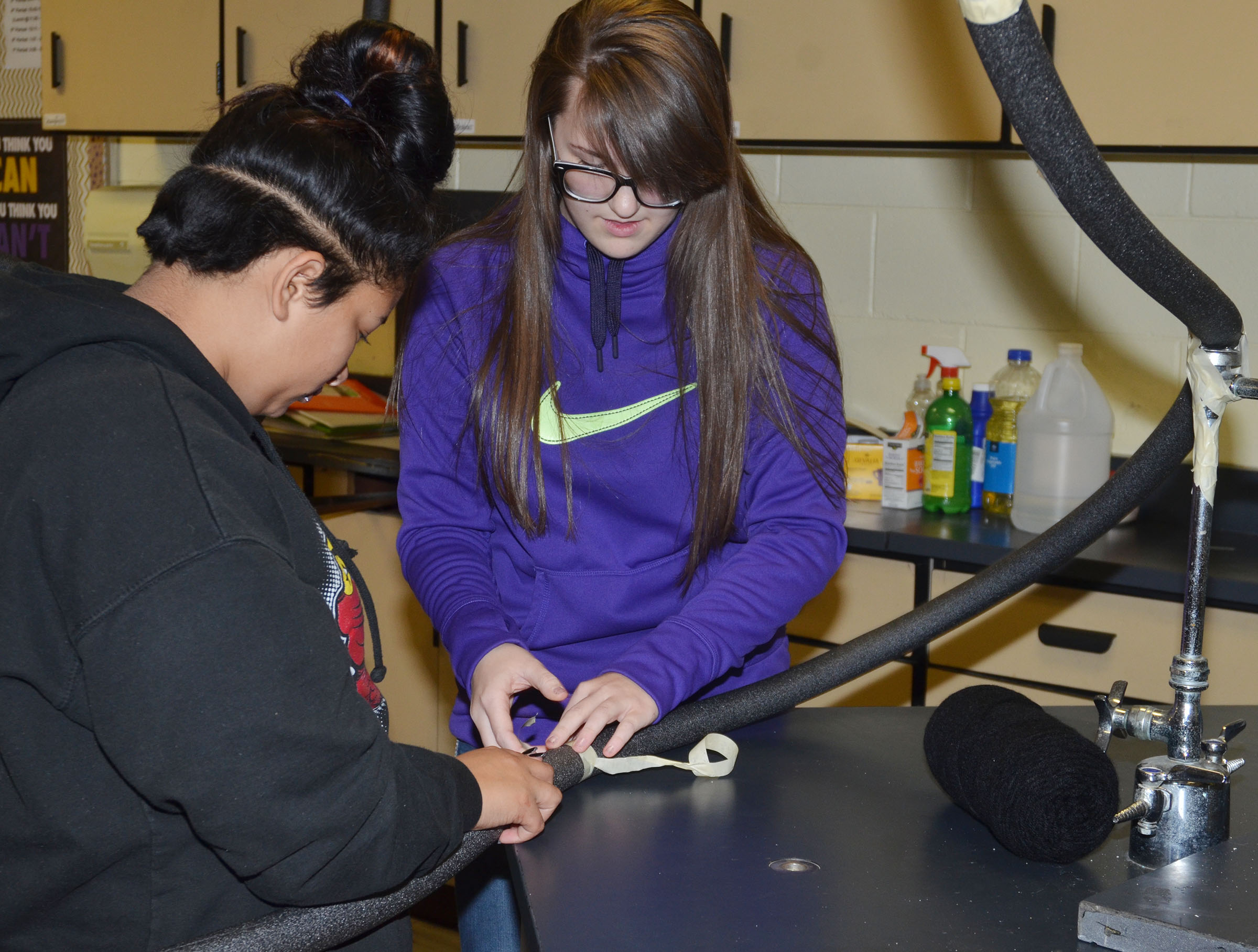 CHS freshmen Cristina Barrera, at left, and Haley Morris build their roller coaster.