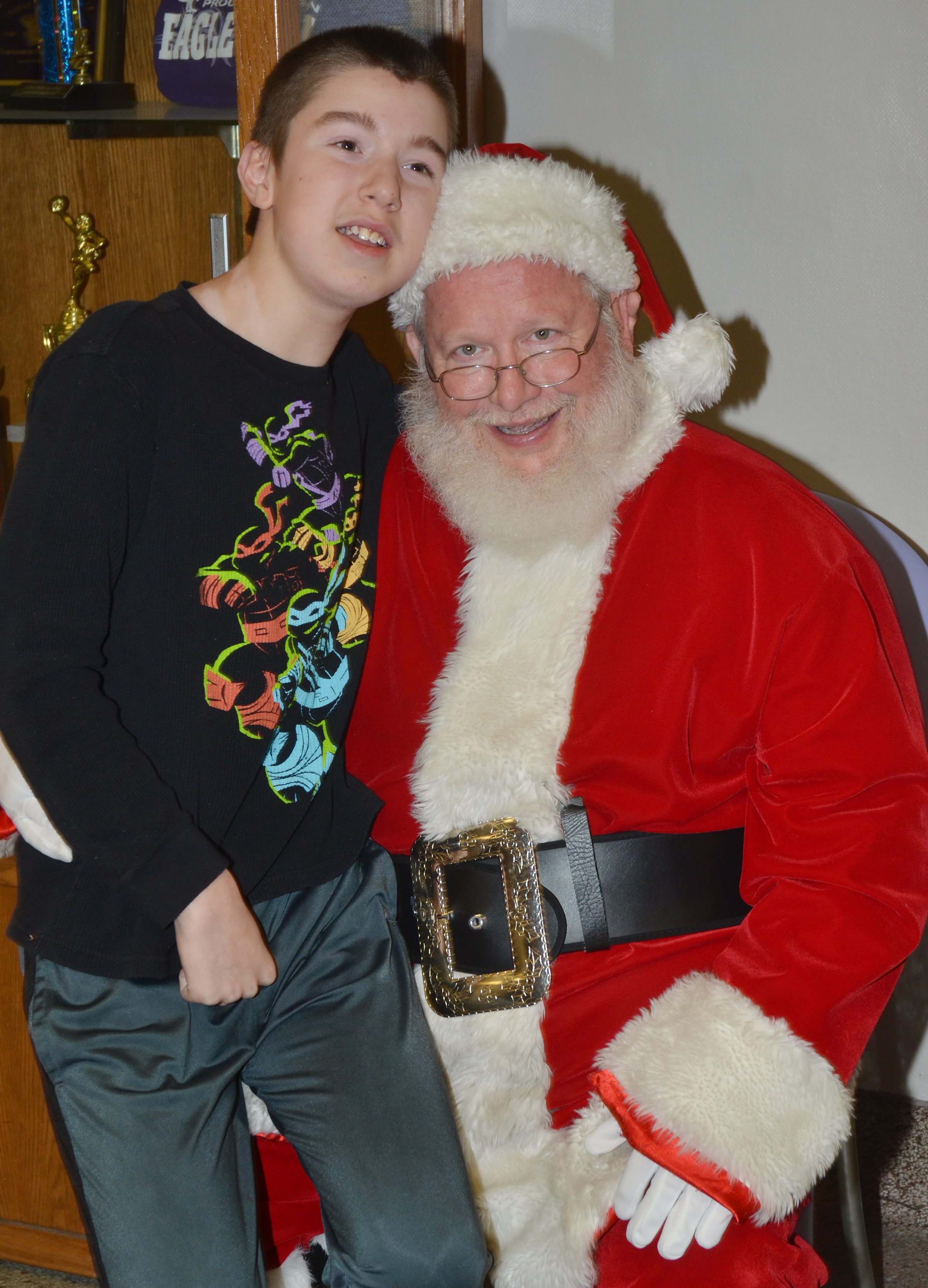 Campbellsville Middle School eighth-grader Jordan Wilson smiles for a photo with Santa.