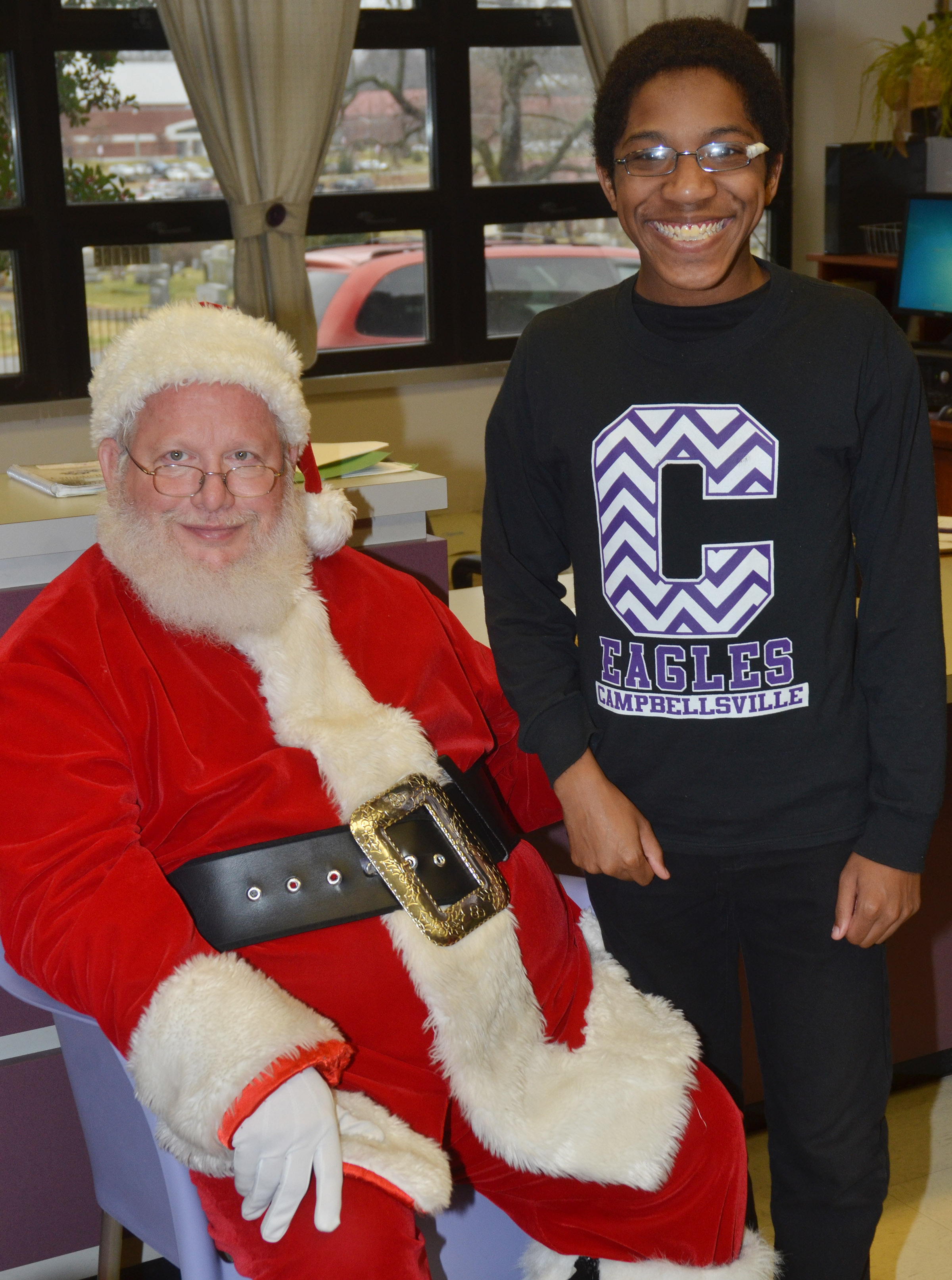 CHS sophomore Travis Nash smiles for a photo with Santa.