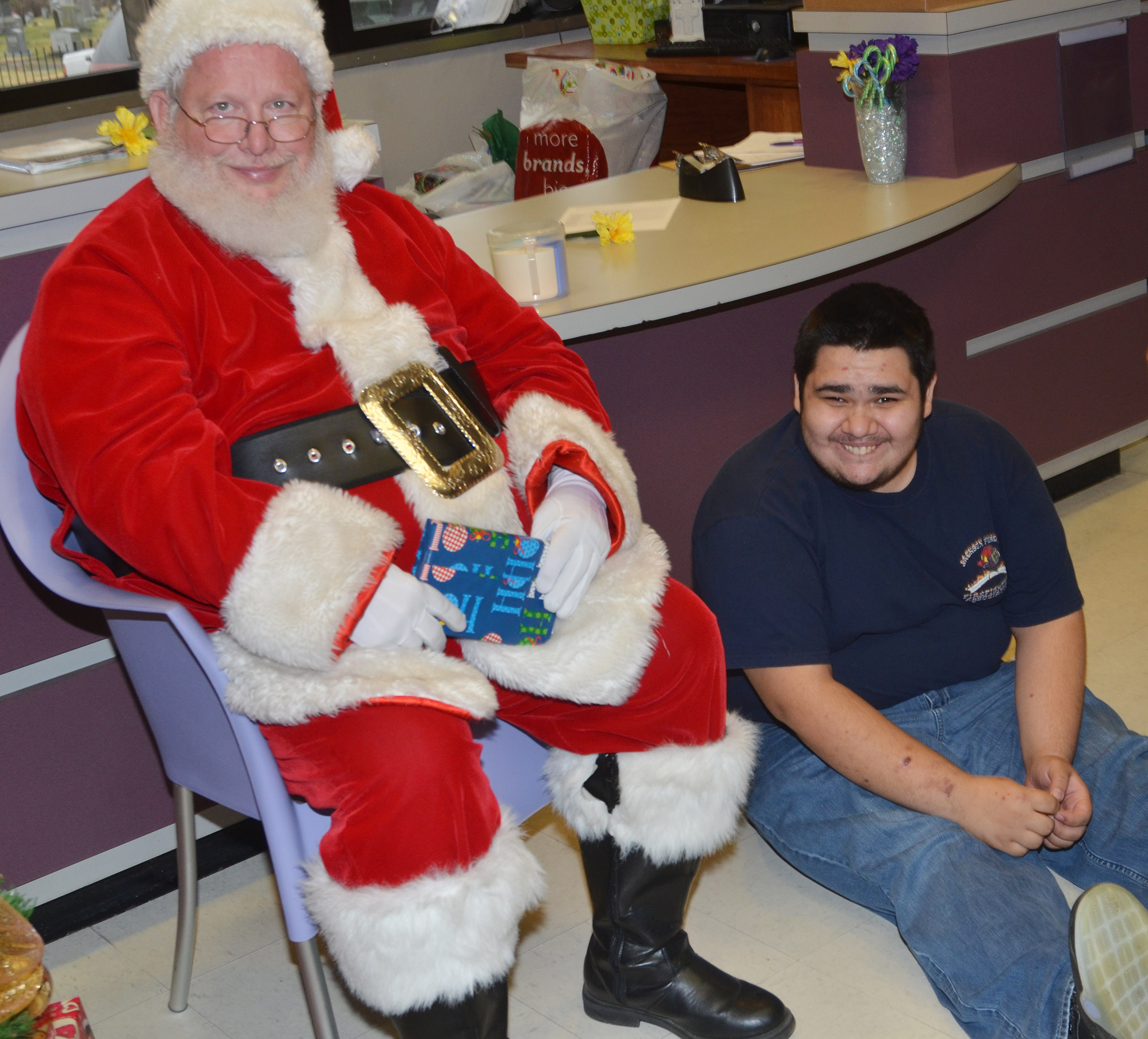 CHS senior Robert Tungate smiles for a photo with Santa.
