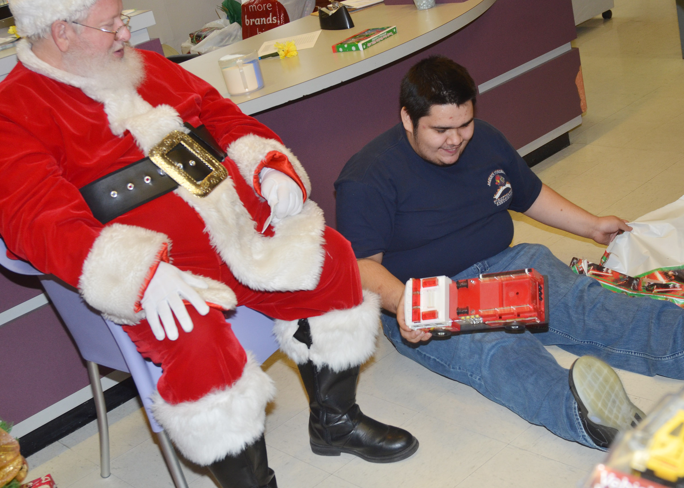 CHS senior Robert Tungate receives a fire truck from Santa.