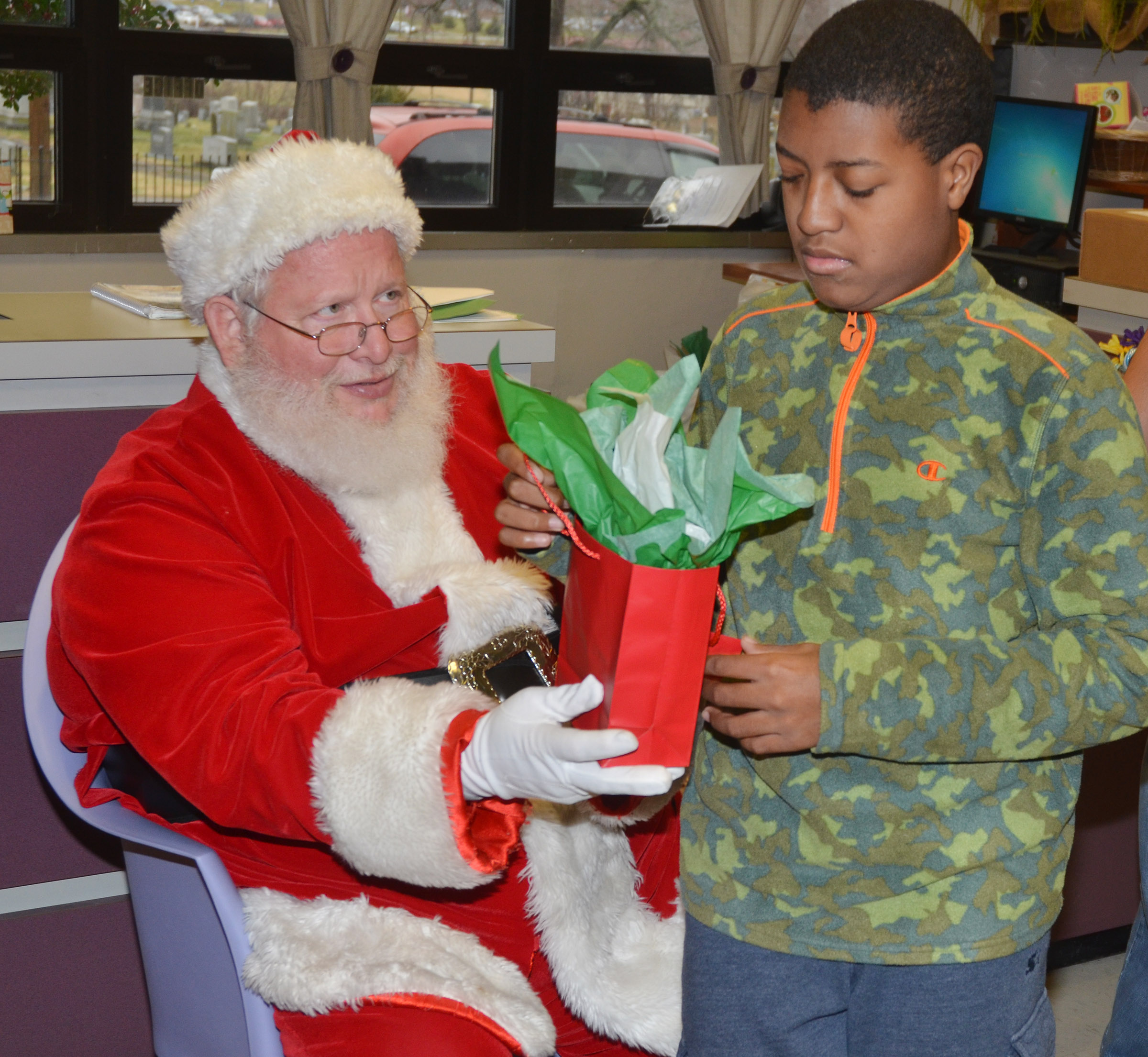 CHS sophomore Chris Moran receives a gift from Santa.