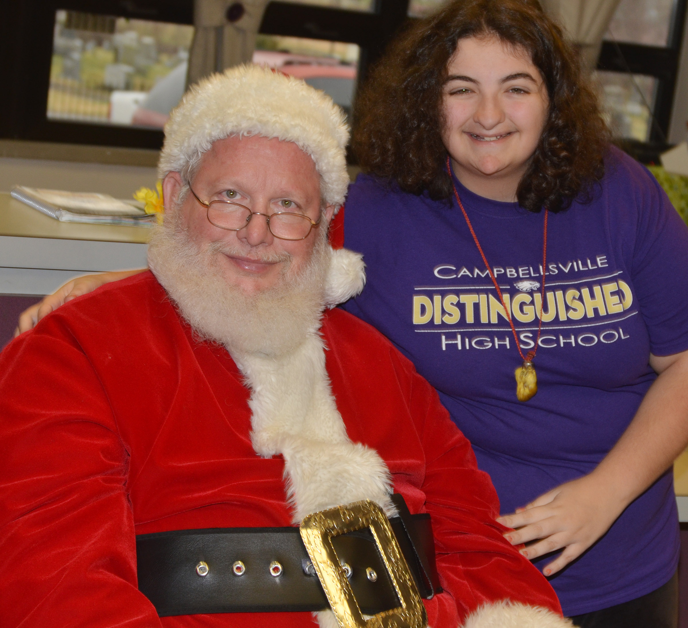 CHS sophomore Brooke Tucker smiles for a photo with Santa.