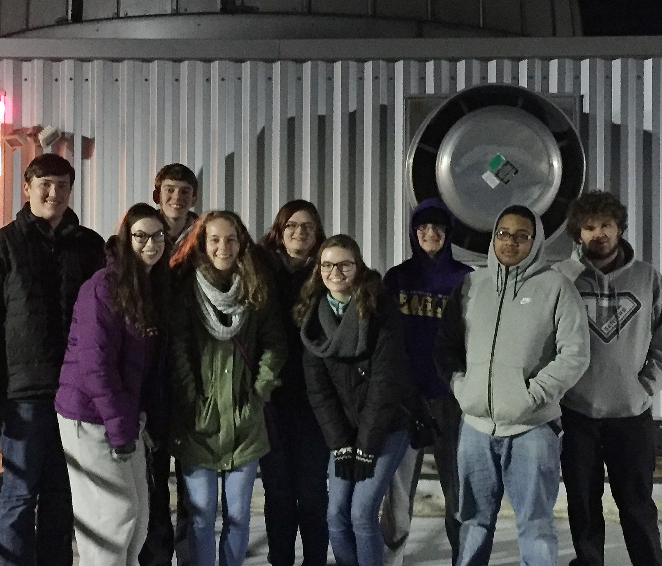 CHS seniors, from left, Zack Settle, Laura Lamb, Murphy Lamb, Caroline McMahan, Vera Brown, Blair Lamb, Ben Rafferty, Ricky Smith-Cecil and Dalton Ballentine take a photo at the MacAdam Student Observatory on the University of Kentucky campus.