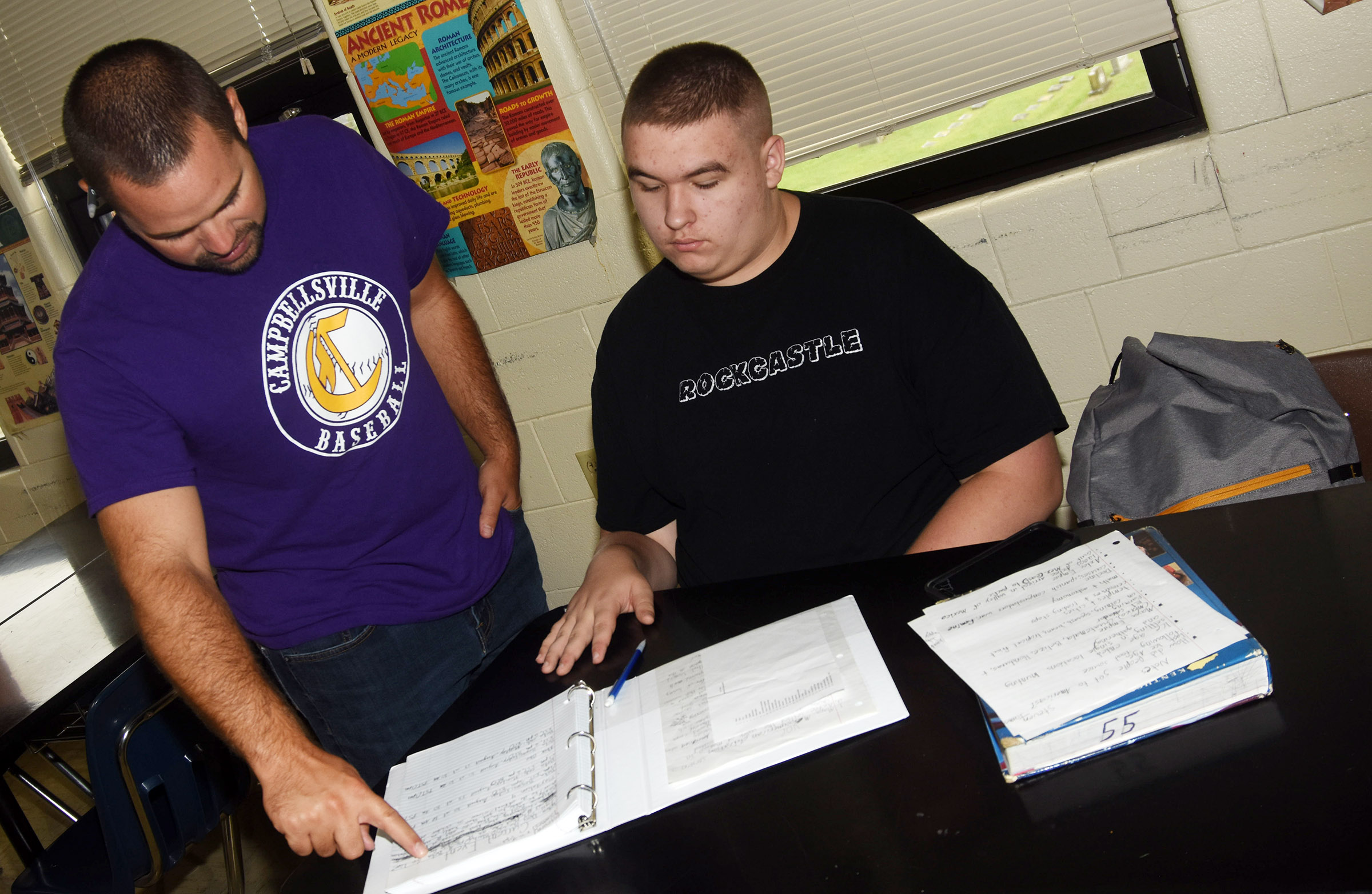 CHS teacher Blake Milby talks to sophomore Steven James about an assignment in his integrated social studies class.