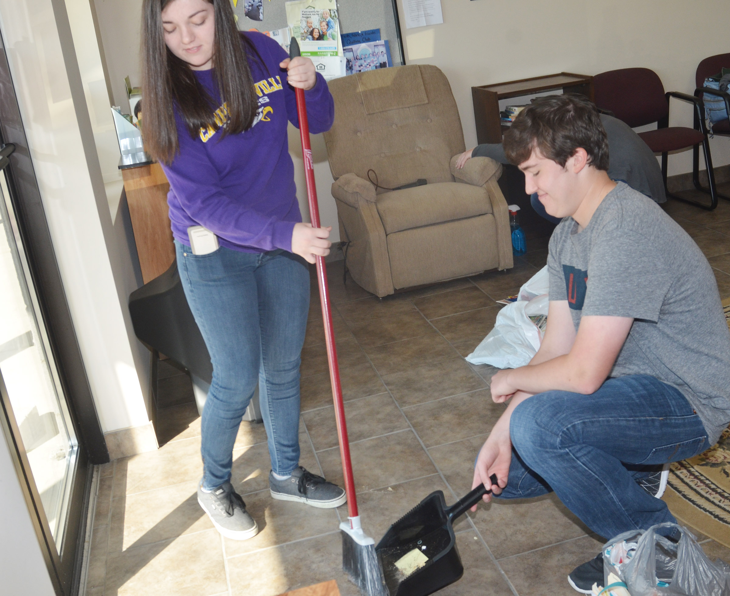 CHS seniors Tiffany Stagner, at left, and Zack Settle sweep at Green River Ministries.